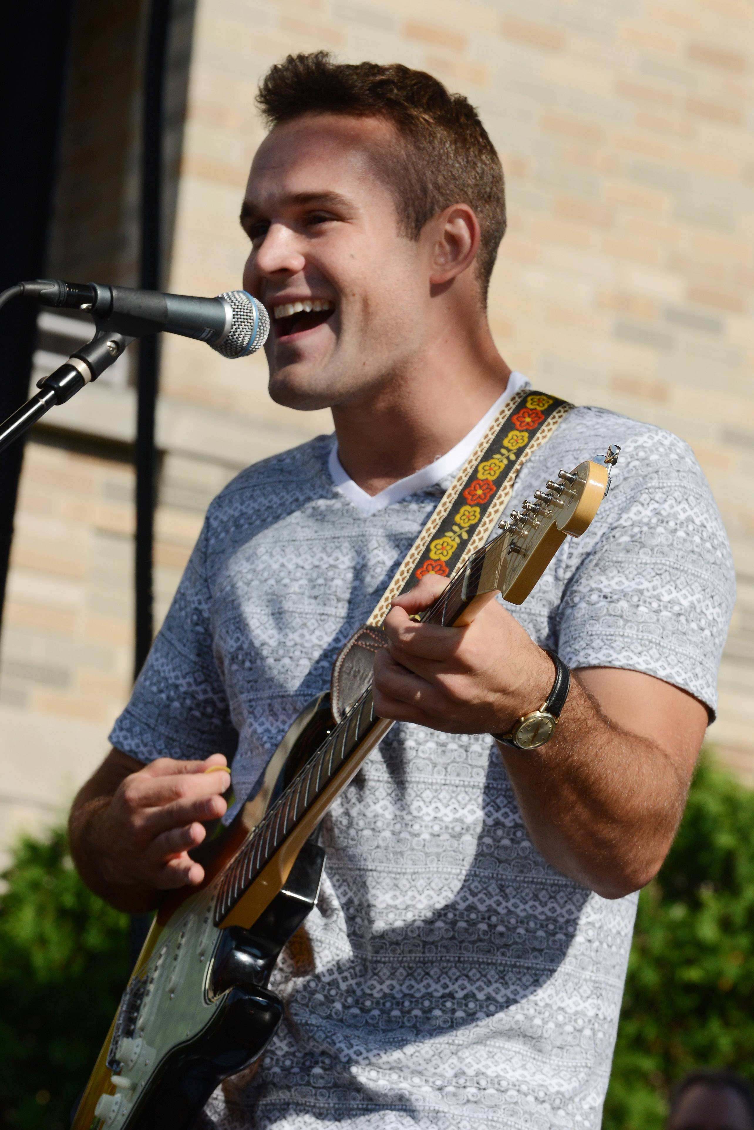 Singer-songwriter Dennis Caravello of Mount Prospect was the winner of Suburban Chicago's Got Talent in 2014. He's pictured here in Arlington Heights at the competition's finale at the Taste of Arlington Heights.