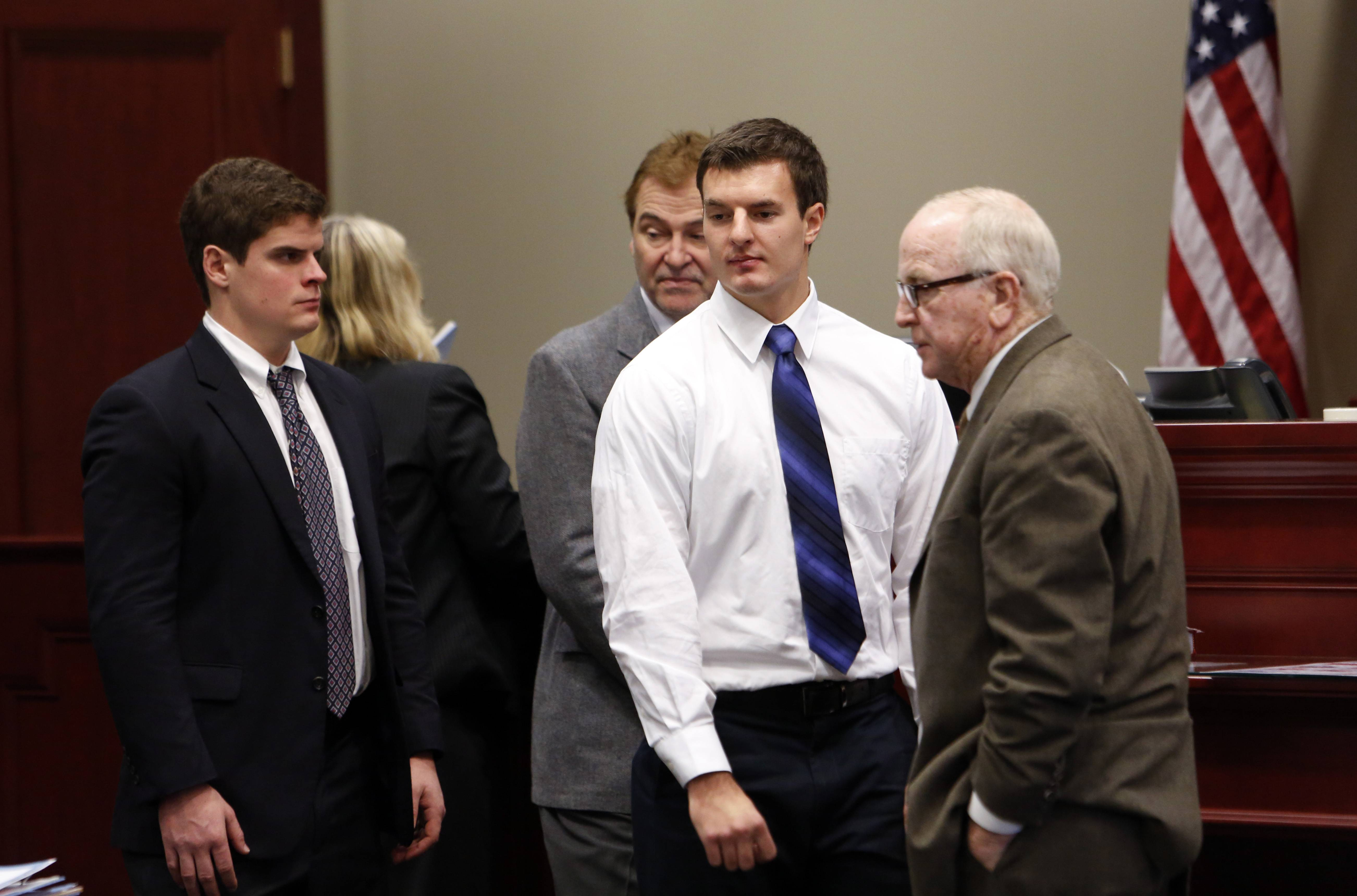 Hazing co-defendant James Harvey, from left, with attorney Brick Van Der Snick, and co-defendant Alexander Jandick, with attorney Jack Donahue, appear at the DeKalb County Courthouse in Sycamore for an October 2013 hearing.