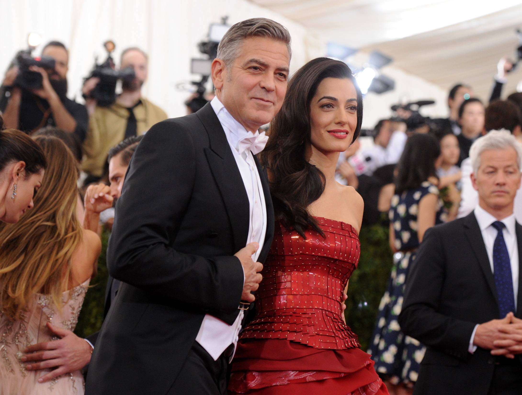 "George Clooney and Amal Clooney arrive at The Metropolitan Museum of Art's Costume Institute benefit gala celebrating ""China: Through the Looking Glass"" on Monday in New York."