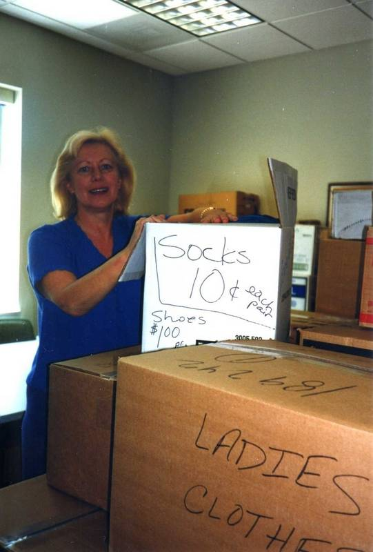 Rose Kurhayez of MB Financial Bank sorts donations for the Mount Prospect Sunrise Rotary clothes drive
