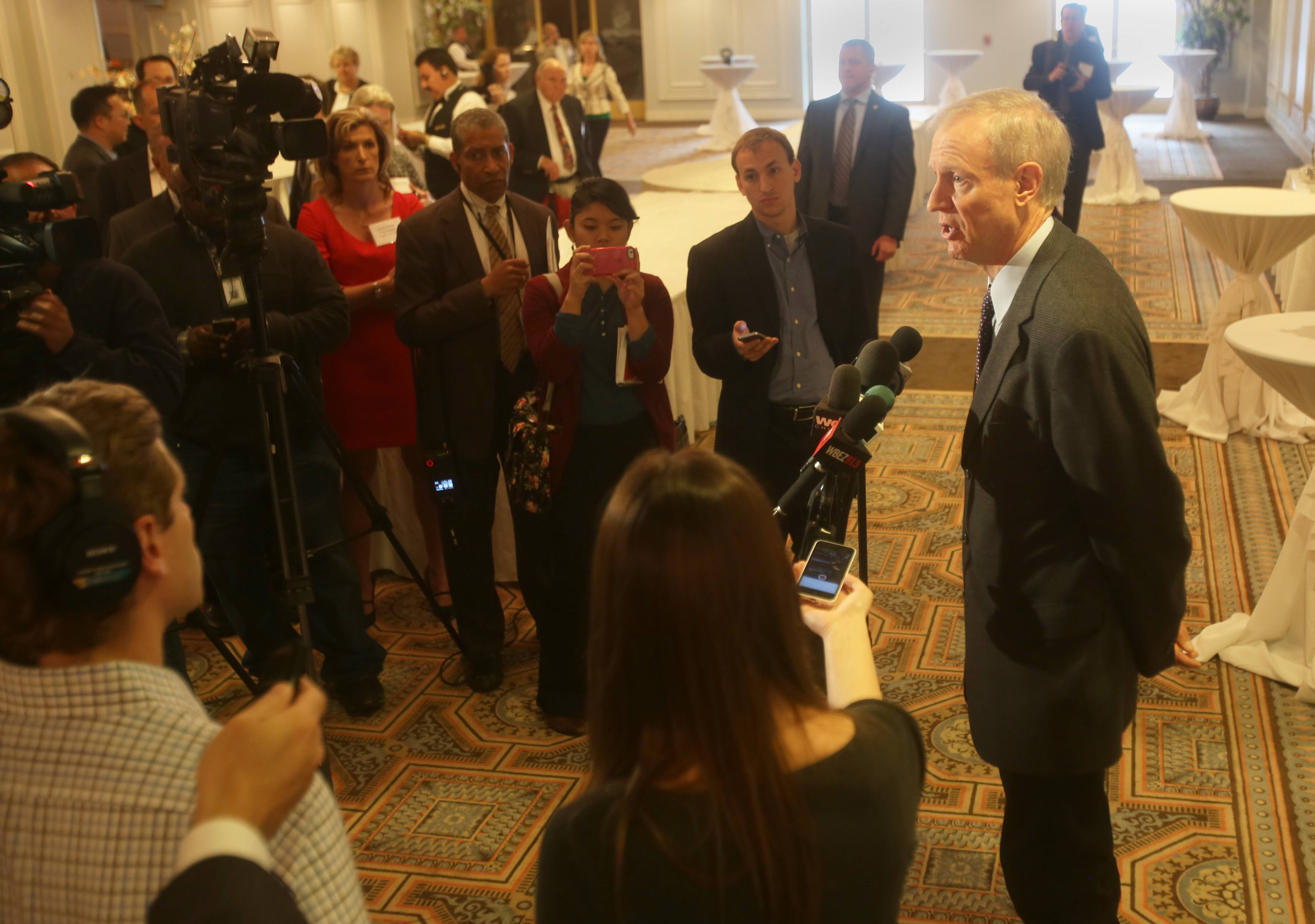 Gov. Bruce Rauner answers questions following his keynote speech at the 6th Annual DuPage County Regional Business Outlook breakfast.