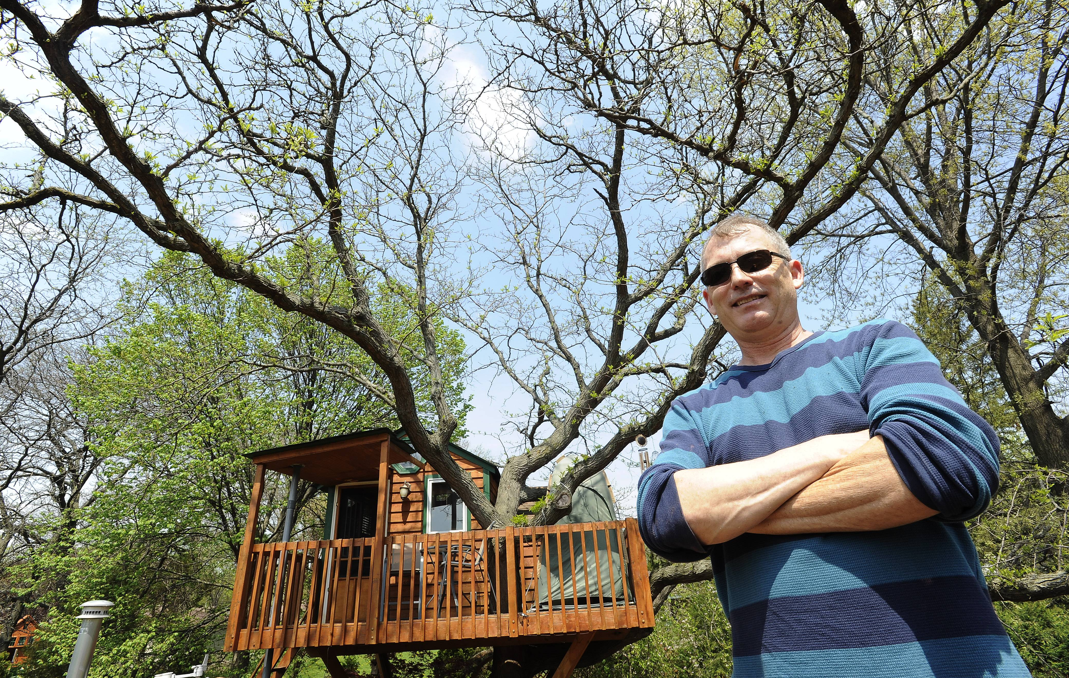 Dan Alexander's 112-square-foot luxury treehouse, seen from the roof of his Schaumburg home, is prompting village officials to seek regulations that would limit the size and scope of future treehouses in town.