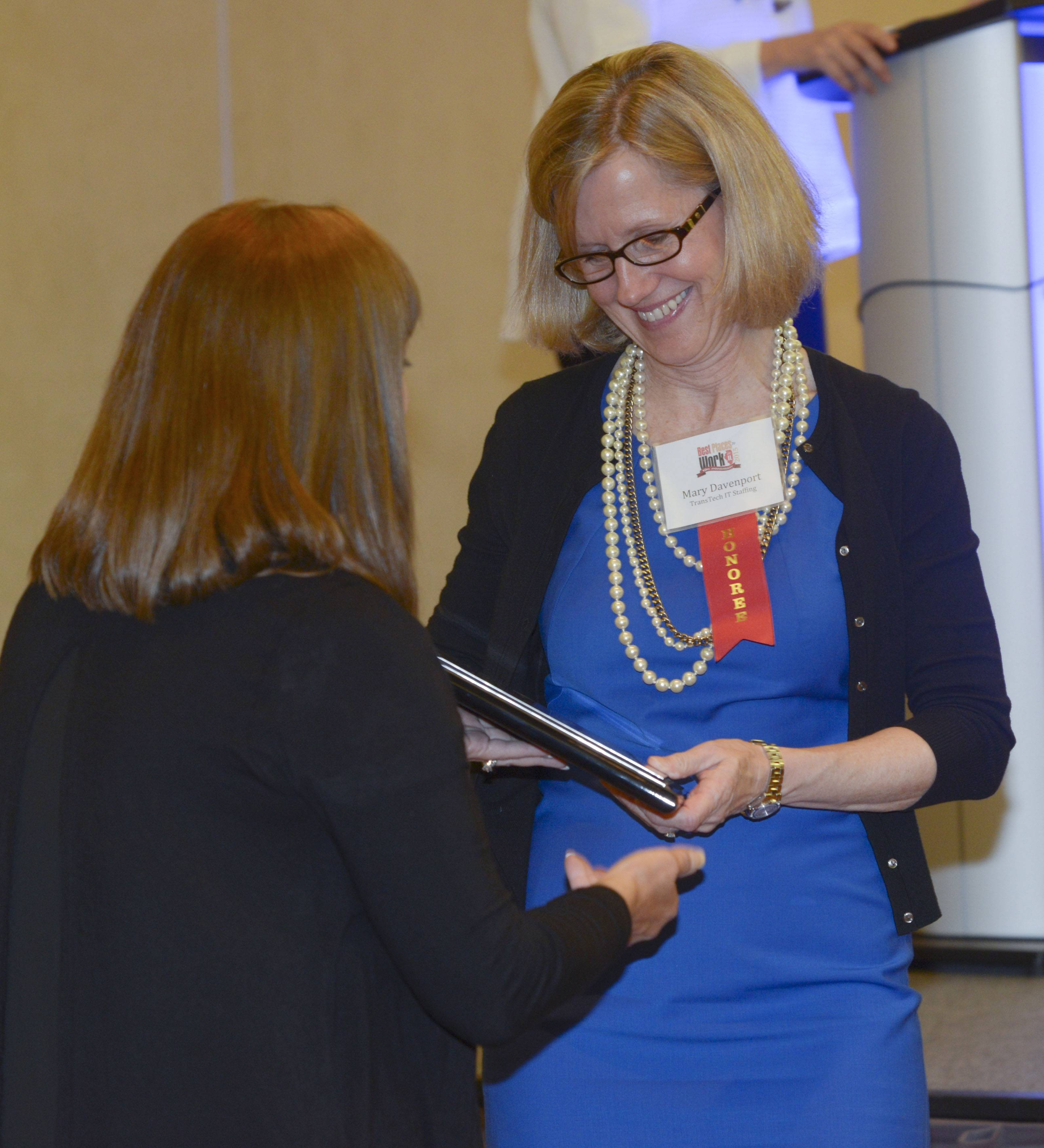 Mary Davenport of TransTech IT Staffing of Itasca accepts the 5th place award for Small Employers during the Daily Herald Business Ledger's 10th annual Best Places to Work in Illinois award ceremony at the Oak Brook Hill Resort & Conference Center in Oak Brook Wednesday night.