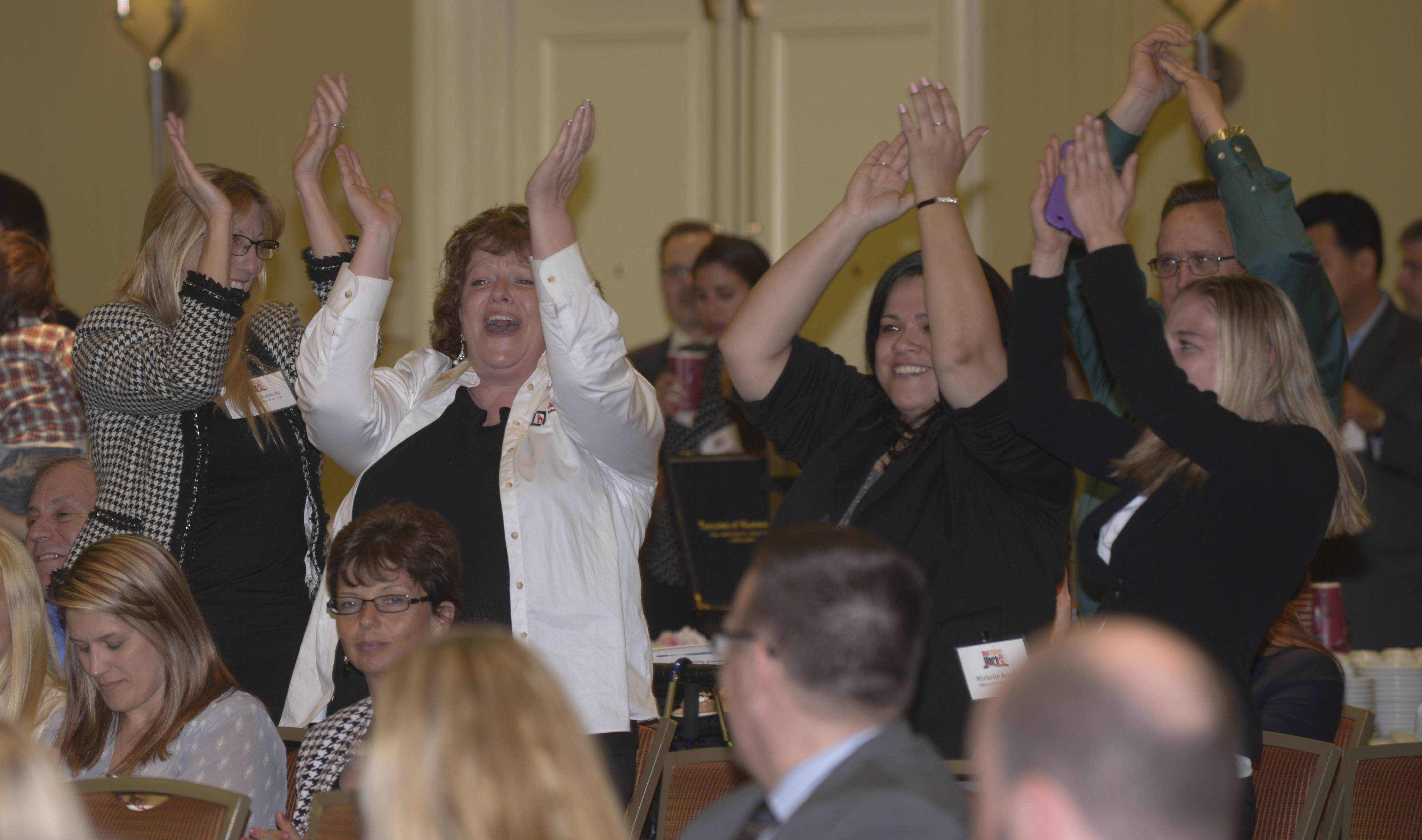 The group from Alliance Disaster Kleenup of Wheeling cheers as their company ranks 4th in the Small Employer division during the Daily Herald Business Ledger 10th annual Best Places to Work in Illinois award ceremony at the Oak Brook Hill Resort & Conference Center in Oak Brook.