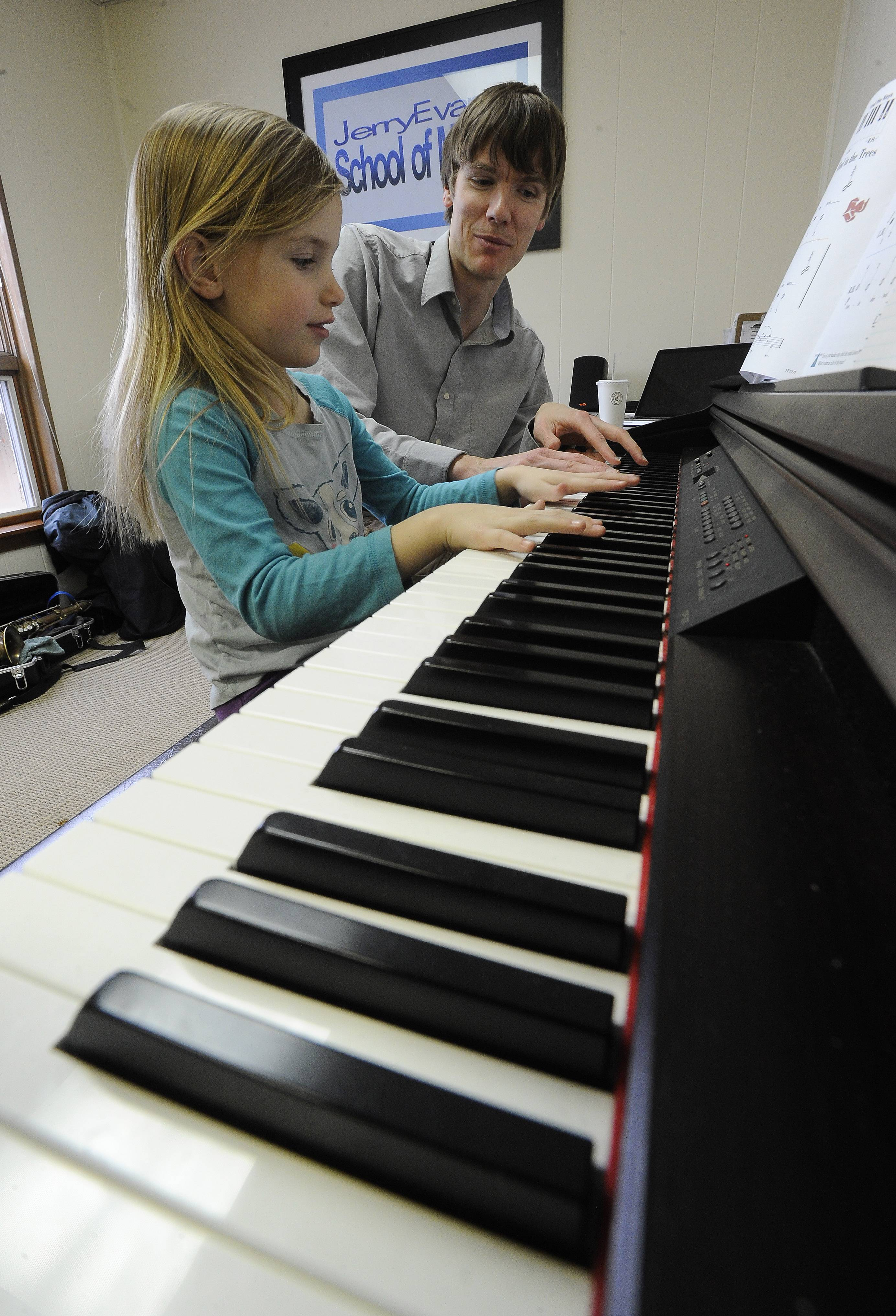 Brown, 31, of Chicago, works with piano student Katherine Monticello.