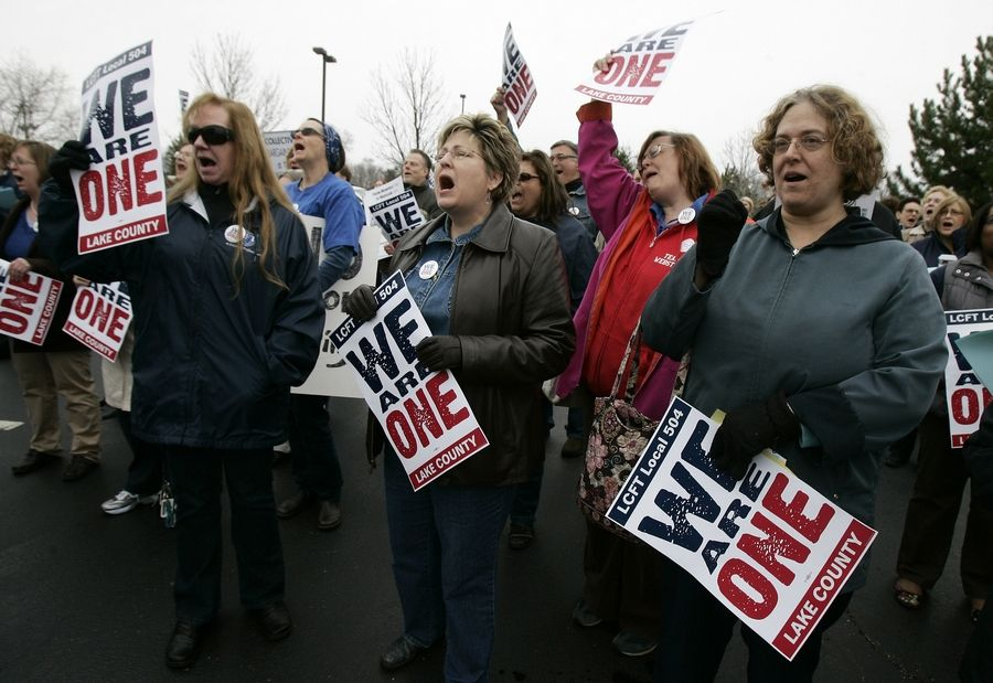 Waukegan teachers Pat LaScola, left, Jeanne Wagner and Vickie Iggo shout support as the Lake County Federation of Teachers union rallied in 2011 in Gurnee against pension cuts.