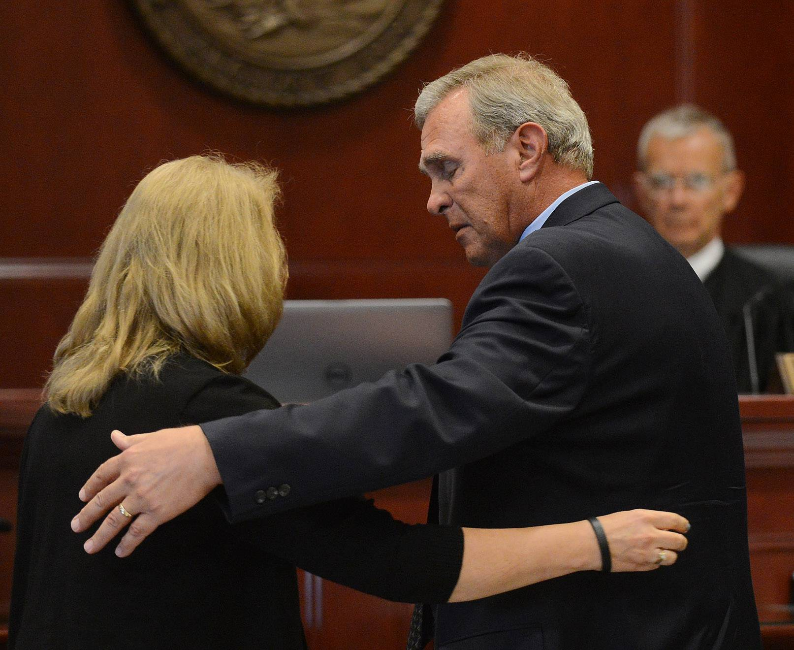 Gary Bogenberger consoles his wife, Ruth, after their victim impact statements after 22 people pleaded guilty to misdemeanor charges stemming from the hazing death of their son, Northern Illinois University freshman David Bogenberger of Palatine, Friday at the DeKalb County Courthouse in Sycamore.
