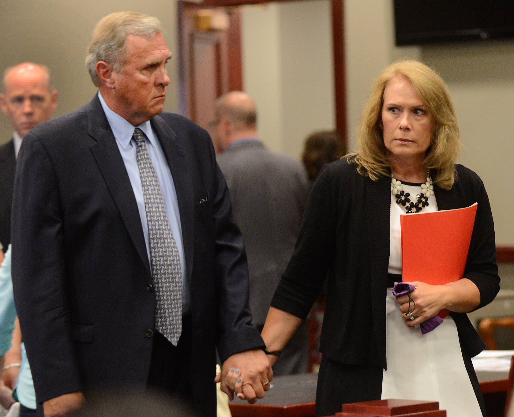 Gary and Ruth Bogenberger enter the courtroom where 22 people pleaded guilty to misdemeanor charges in the hazing death of their son, Northern Illinois University freshman David Bogenberger of Palatine, at the DeKalb County Courthouse in Sycamore on Friday.