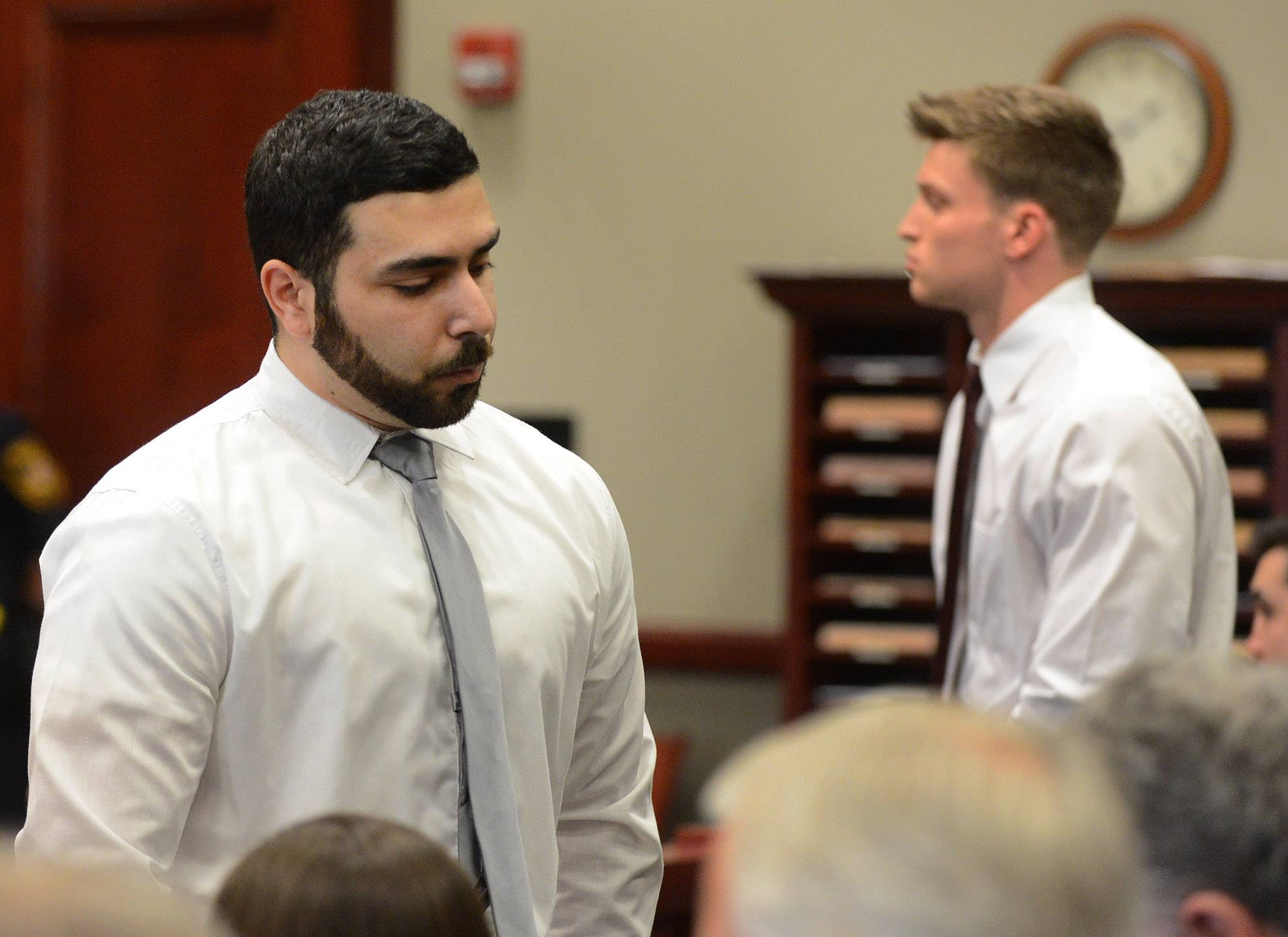 Omar Salameh, of DeKalb, left, and Steven A. Libert, of Naperville, background, pleaded guilty to a reckless conduct misdemeanor charge in the hazing death of Northern Illinois University freshman David Bogenberger of Palatine Friday at the DeKalb County Courthouse in Sycamore.