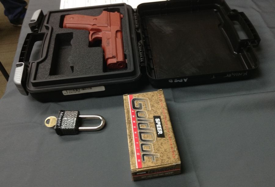 The TSA demonstrates the type of case permitted for transporting firearms in checked luggage on planes.