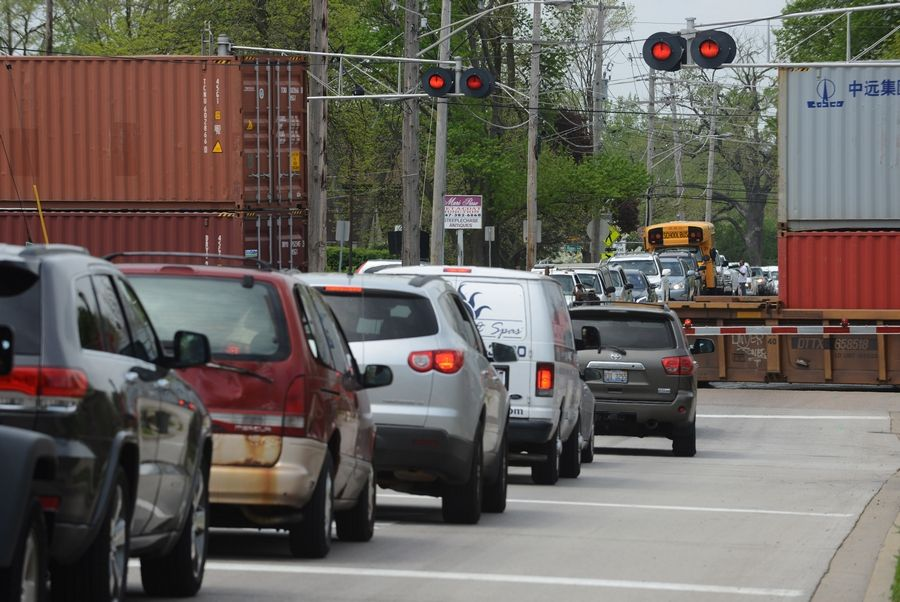 Traffic backs up as a CN container train passes the Lake-Cook Road crossing in Barrington.