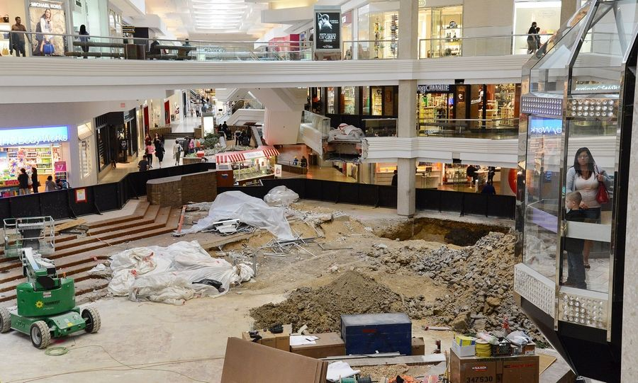 Construction is at its peak on the $13.9 million renovation of Woodfield Mall in Schaumburg. Despite the mess, mall management says shoppers and tenant continue to flock to the shopping center.