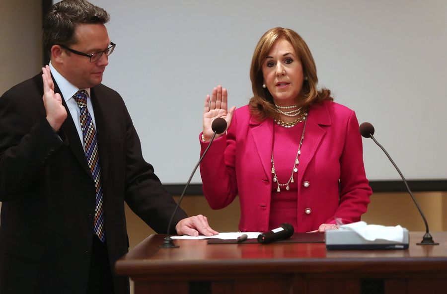 Elizabeth Brandt is sworn in Monday as the new Lincolnshire mayor by Village Manager Brad Burke at village hall.