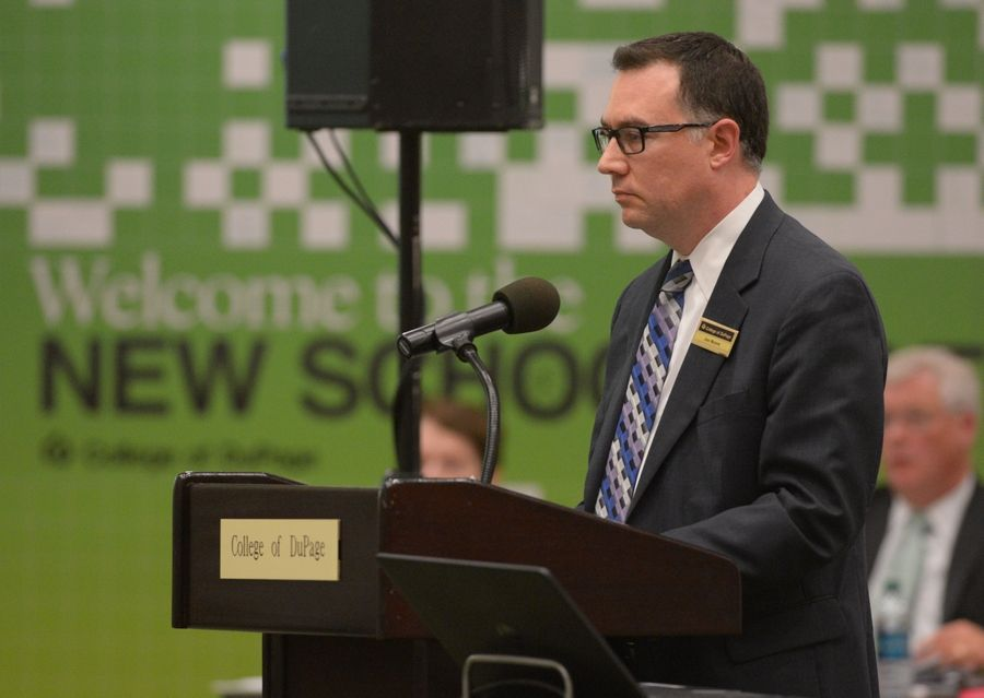 Joe Moore, College of DuPage vice president of marketing and communications, explains how a series of mailers were created, paid for and mailed out before the last election during a special College of DuPage board meeting Thursday.