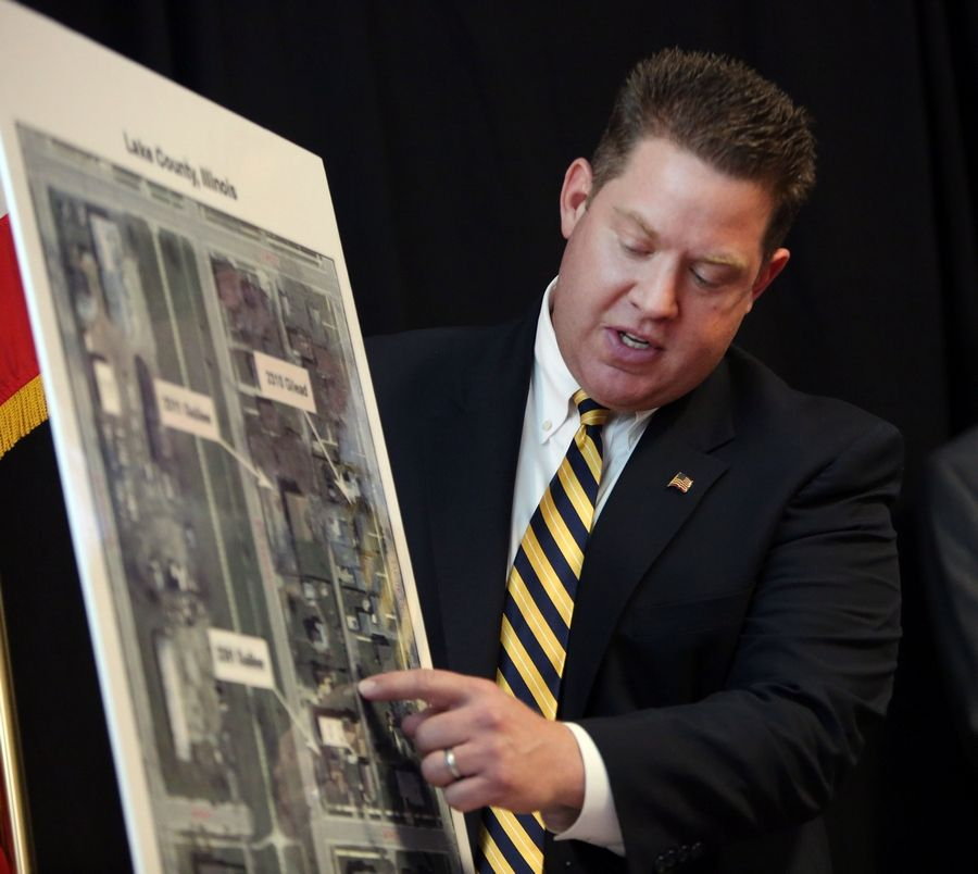 Lake County State's Attorney Mike Nerheim points to a map of the scene where 17-year-old Justus Howell was shot to death by a Zion police officer last month. Nerheim said Thursday he would not charge the officer, saying his actions were justified.