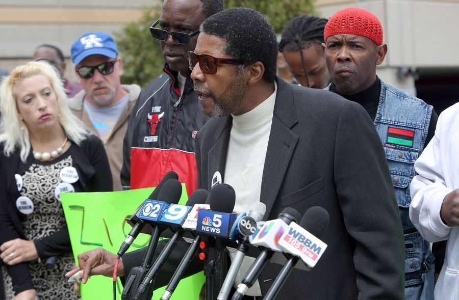"Ralph Peterson of Waukegan protests Lake County State's Attorney Mike Nerheim's decision not to bring charges against a Zion police officer who shot and killed a teenager last month. Nerheim said the teen, Justus Howell, was ""armed and dangerous"" and the officer's actions were justified."