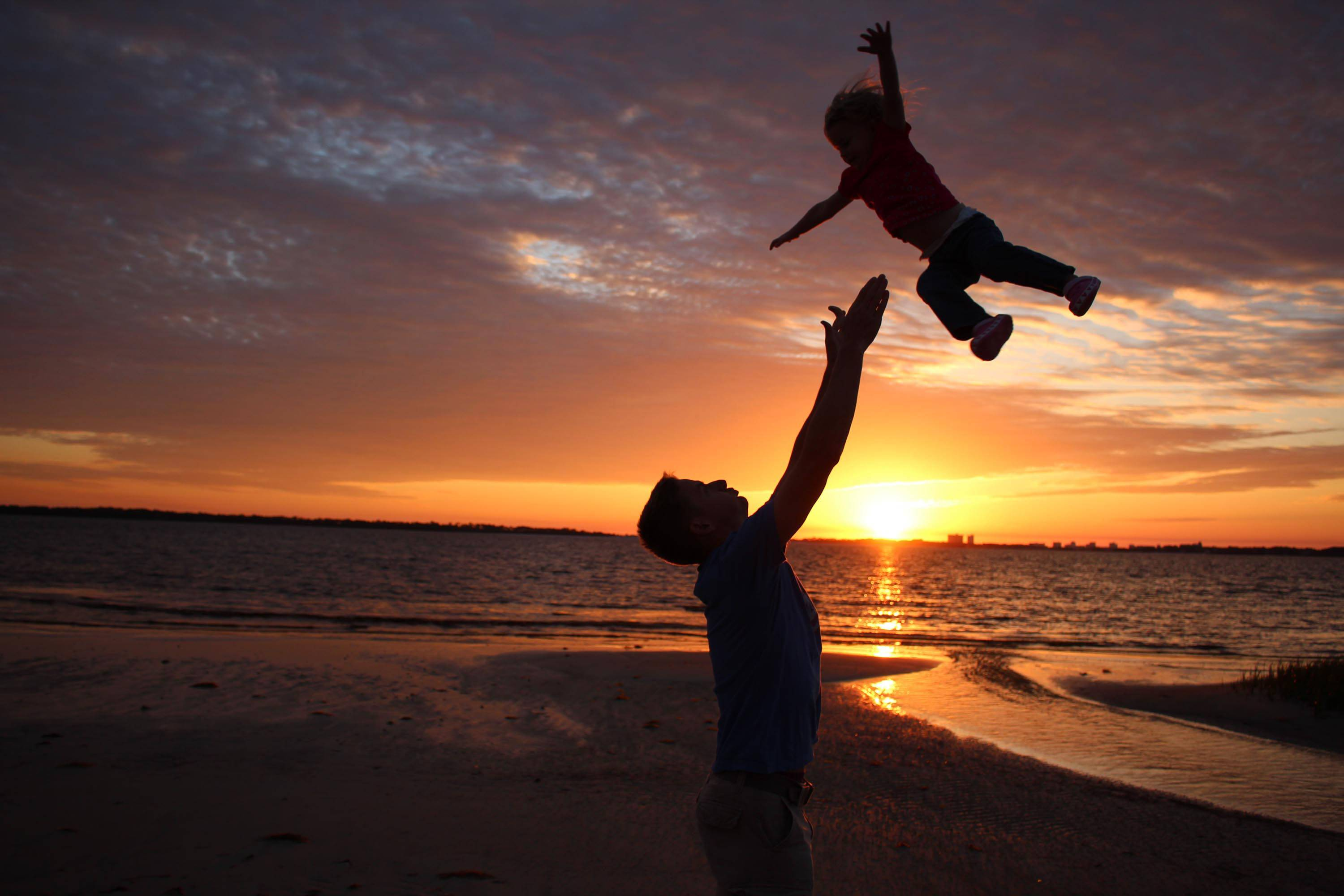 This photo was taken of my son, Lt. Col. Patrick Godfrey tossing his daughter in the air at sunset at Tyndall Air Force Base in Panama City, FL when I was visiting recently.