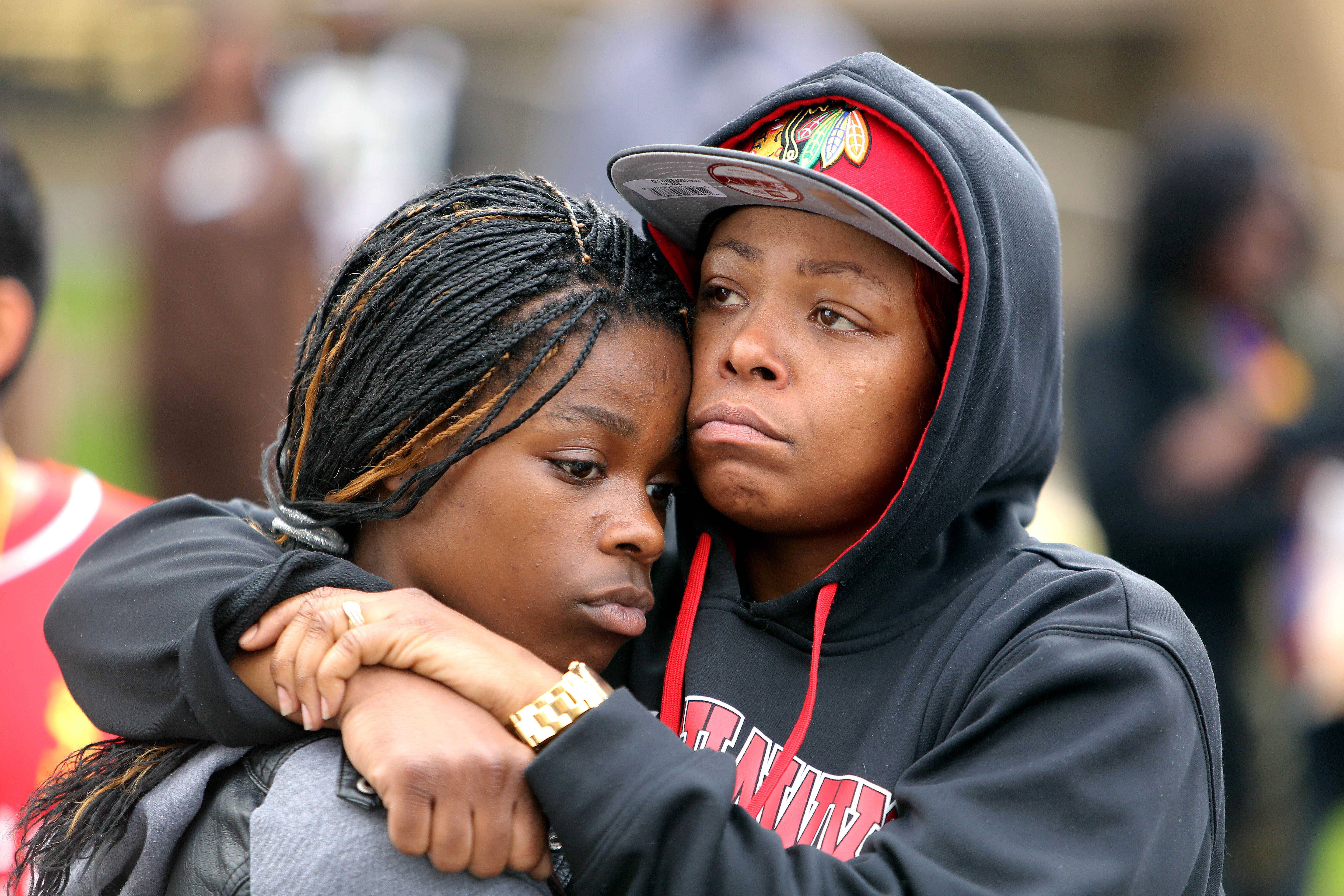 LaToya Howell of Waukegan, right, hugs her 12-year-old daughter Jayla as people protest State's Attorney Michael Nerheim's decision that a Zion police officer was justified in fatally shooting teenager Justus Howell last month.