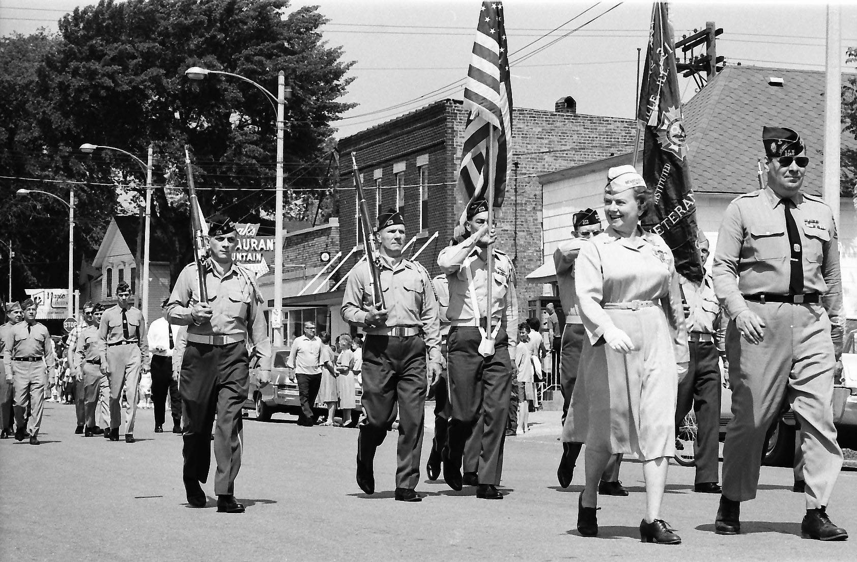 Scouts march in a Memorial Day parade, Mount Prospect, 1965.