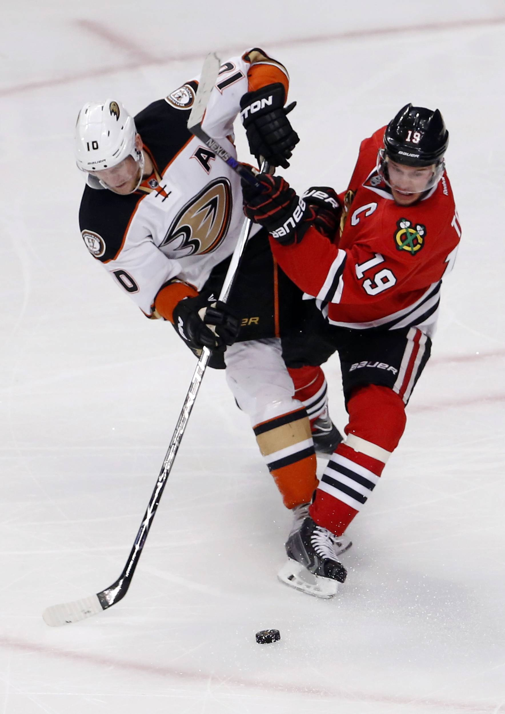 Anaheim Ducks right wing Corey Perry (10) and Chicago Blackhawks center Jonathan Toews (19) vie for the puck during the second period in Game 3 of the Western Conference finals of the NHL hockey Stanley Cup playoffs, Thursday, May 21, 2015, in Chicago.