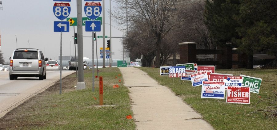 Clutter from election signs is nothing new, as this photo from 2011 demonstrates. But now Naperville officials are considering ways to reduce the amount of time such signs are up.