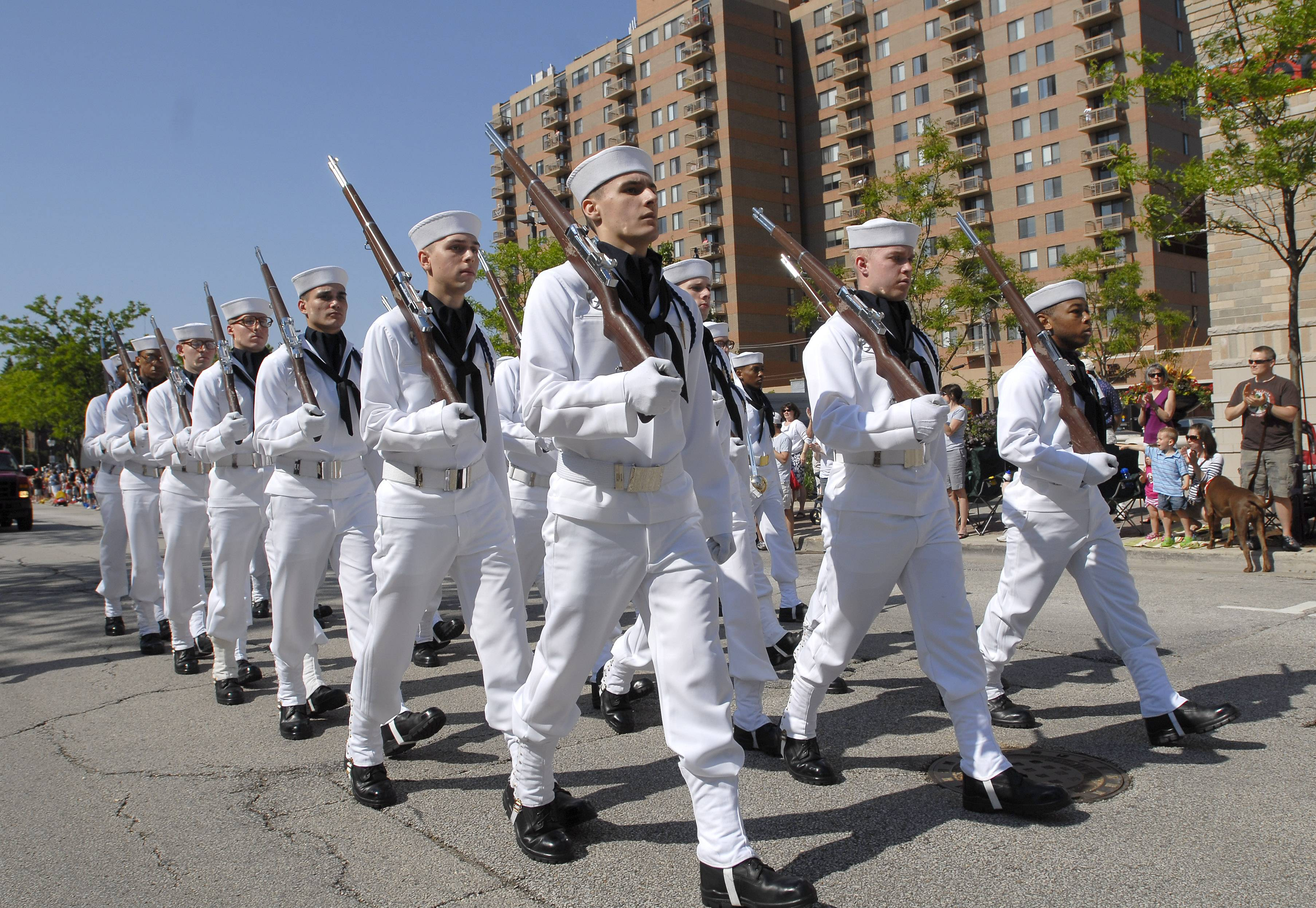 Sailors march in their dress whites at the 2011 Memorial Day parade Monday in Arlington Heights.