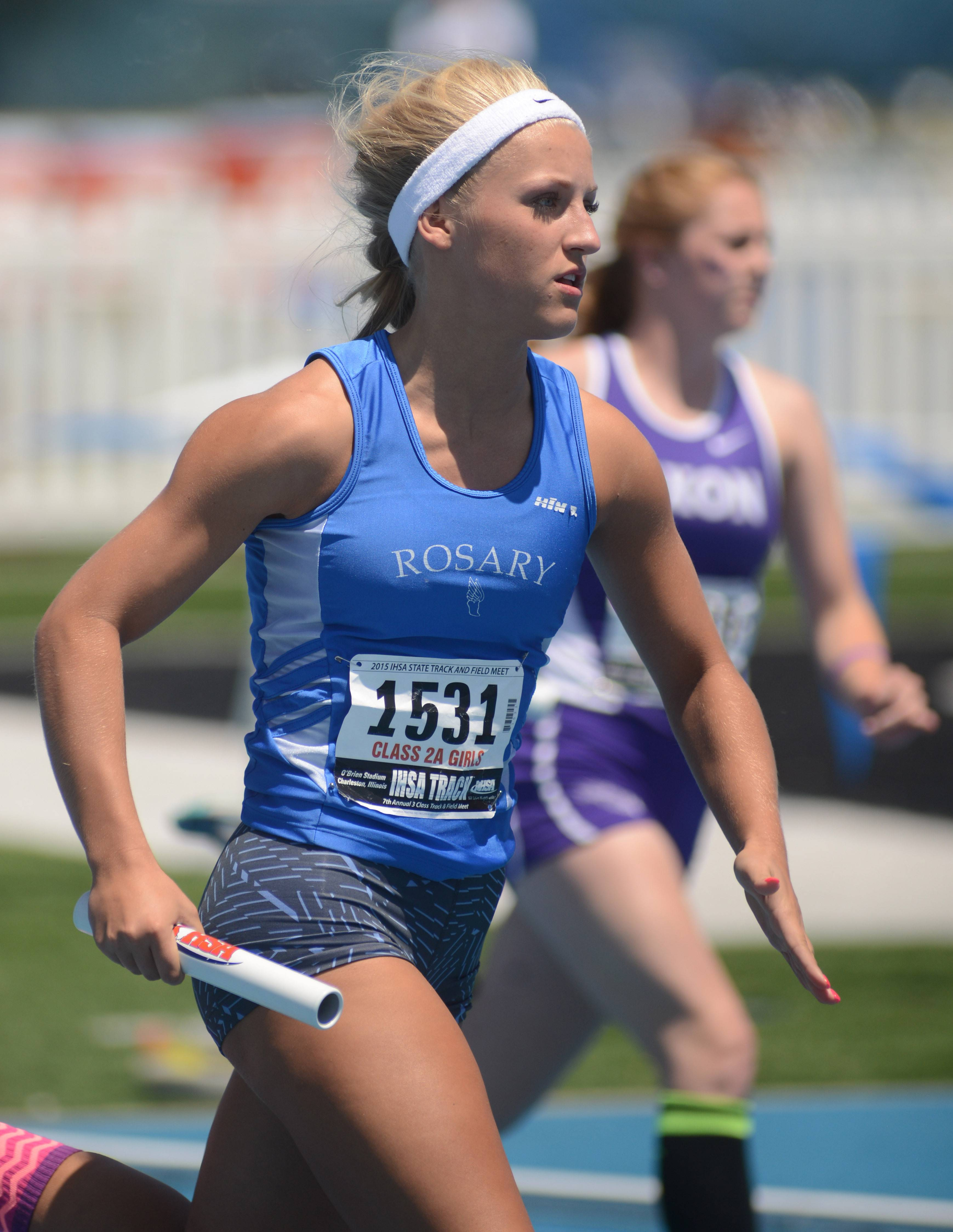 Rosary's Maddie Saloga in the second heat of the 1600-meter relay in the Class 2A semifinals at the IHSA state track finals at O'Brien Stadium in Charleston, IL Friday. Rosary's Maddie Saloga