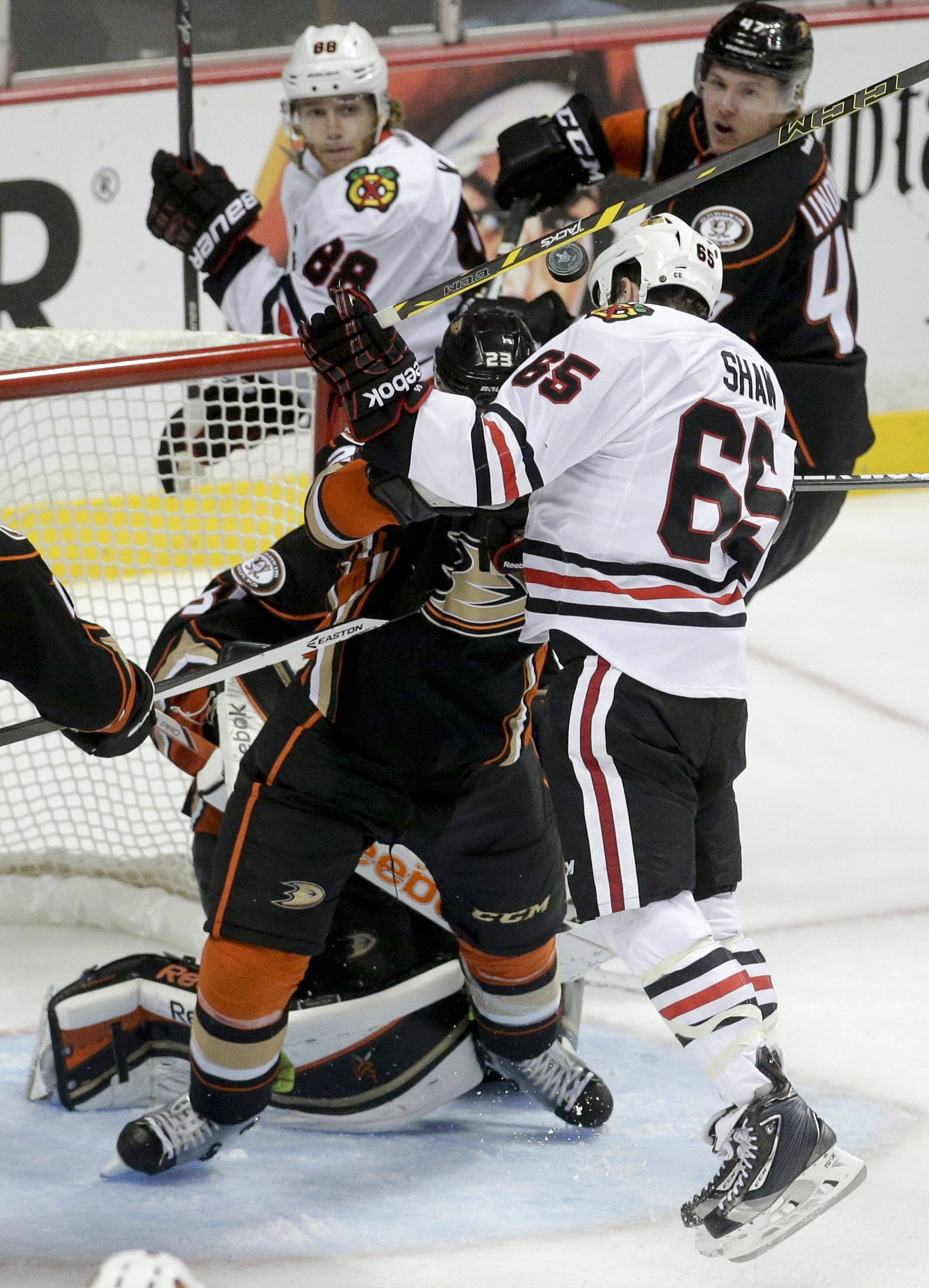 Chicago Blackhawks center Andrew Shaw head-butts the puck into the goal during overtime in Game 2 of the Western Conference final during the NHL hockey Stanley Cup playoffs against the Anaheim Ducks in Anaheim, Calif., on Tuesday, May 19, 2015. The apparent goal was disallowed.
