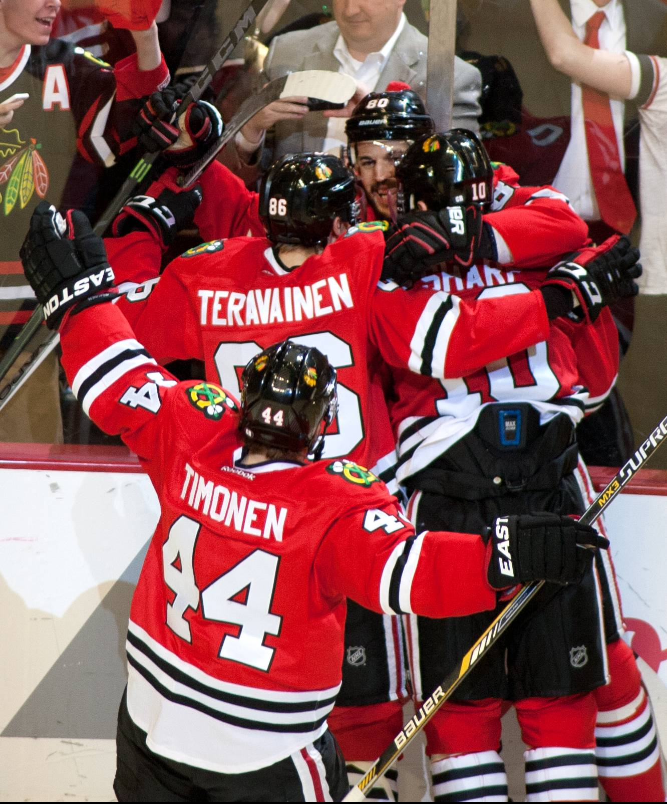 Chicago Blackhawks center Antoine Vermette is mobbed by teammates who celebrate his double overtime 5-4 game winning goal over the Anaheim Ducks during Game 4 of the NHL Western Conference finals on Saturday, May 23, 2015 at the United Center.