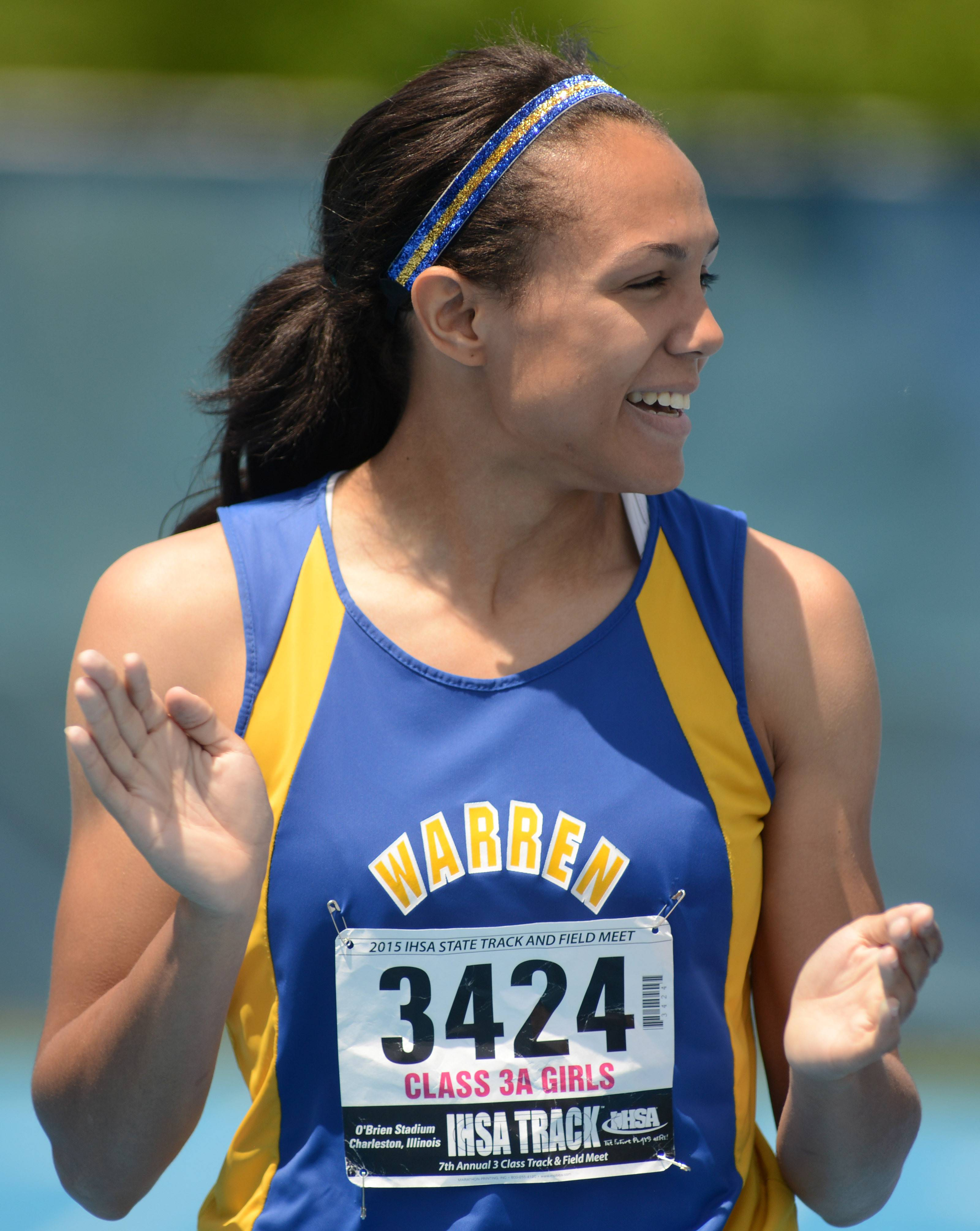 Warren's Brittny Ellis celebrates her victory in the 100-meter dash during the Class 3A state finals on Saturday O'Brien Stadium in Charleston.