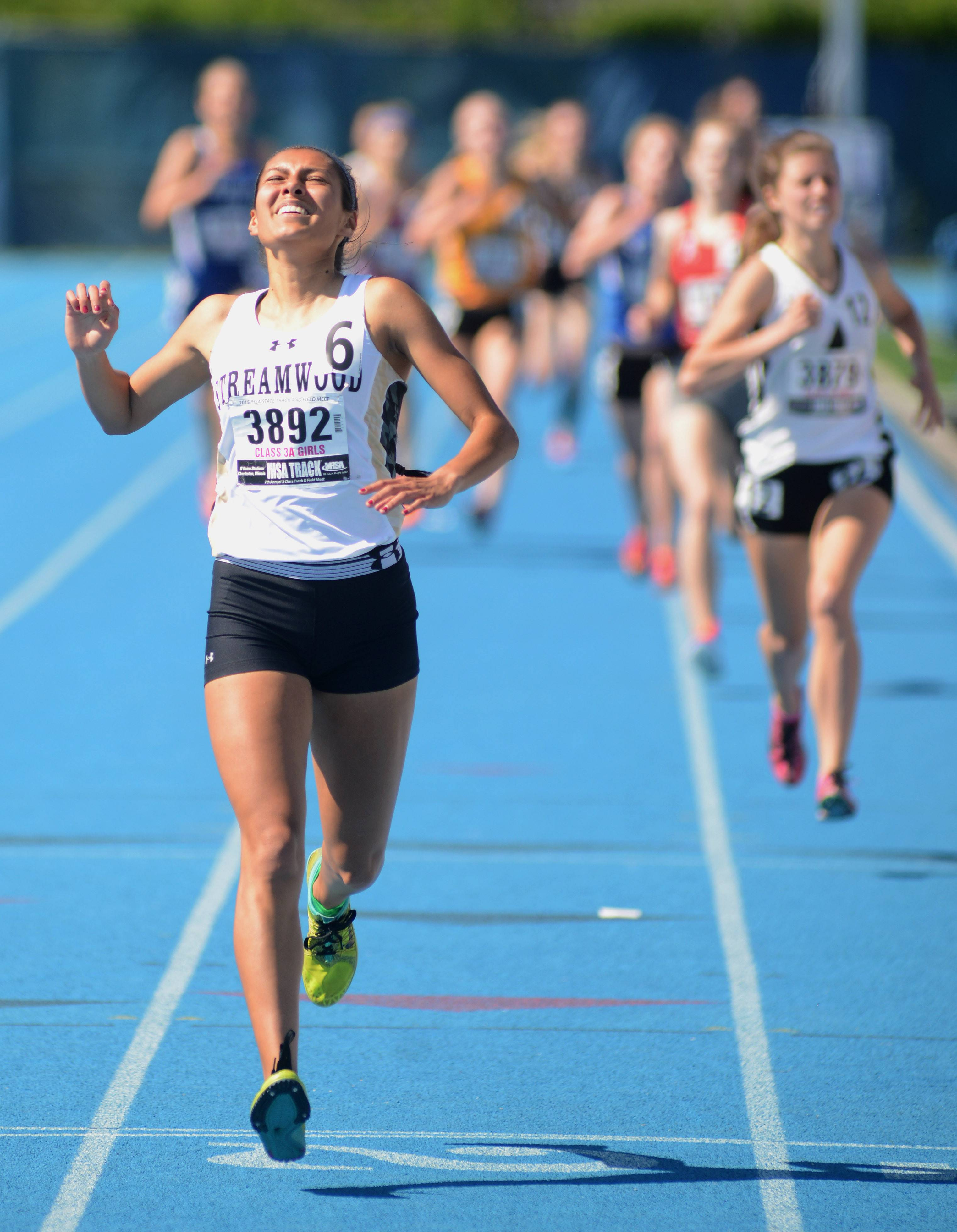 Streamwood's Gabby Juarez wins the 1,600-meter run in the IHSA Class 3A state finals at O'Brien Stadium in Charleston Saturday.