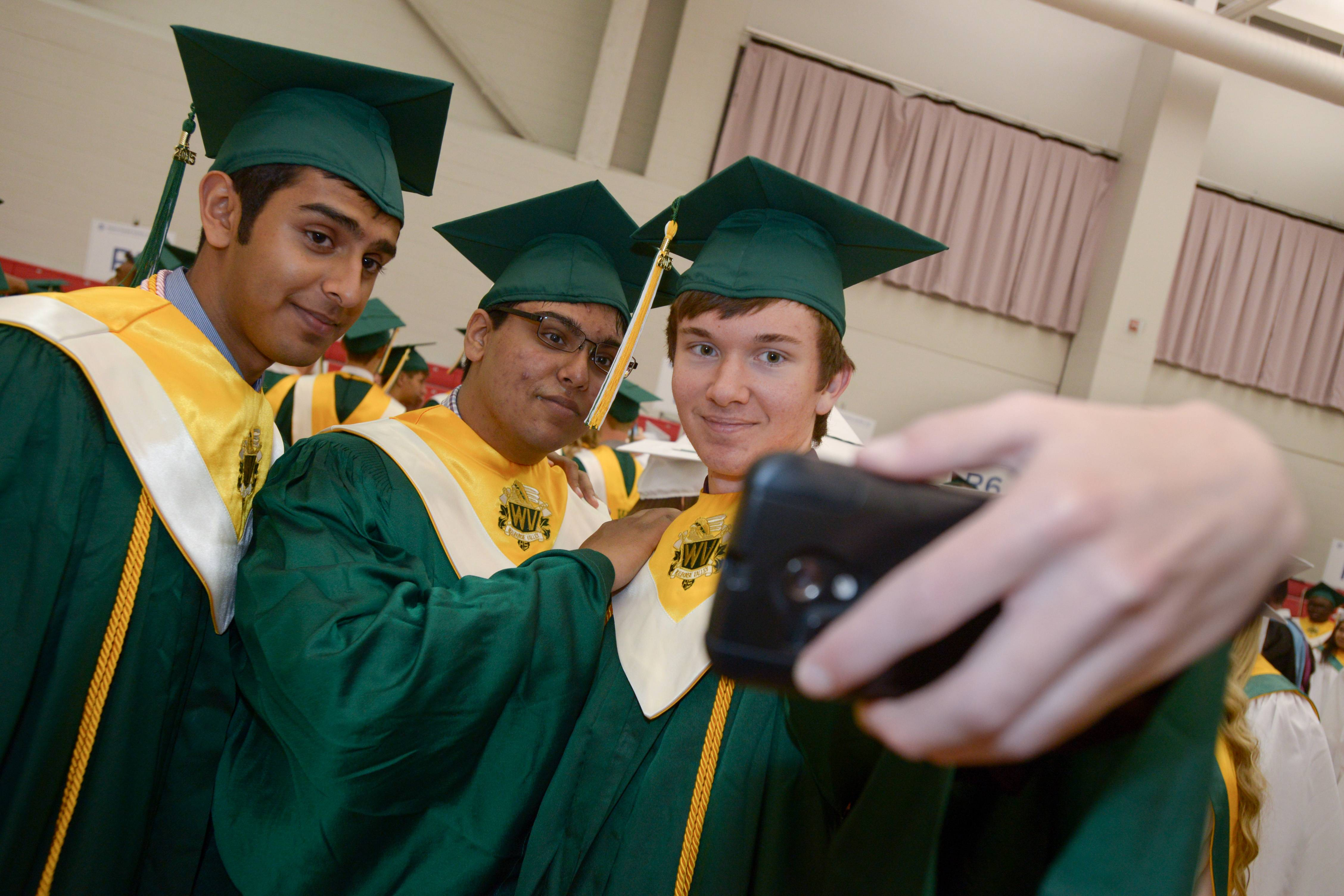 Sthitadhi Chakraborty, Neil Shah and Pierce Blazina take a selfie before the start of the Waubonsie Valley High School graduation on Sunday, May 24 at NIU in DeKalb.