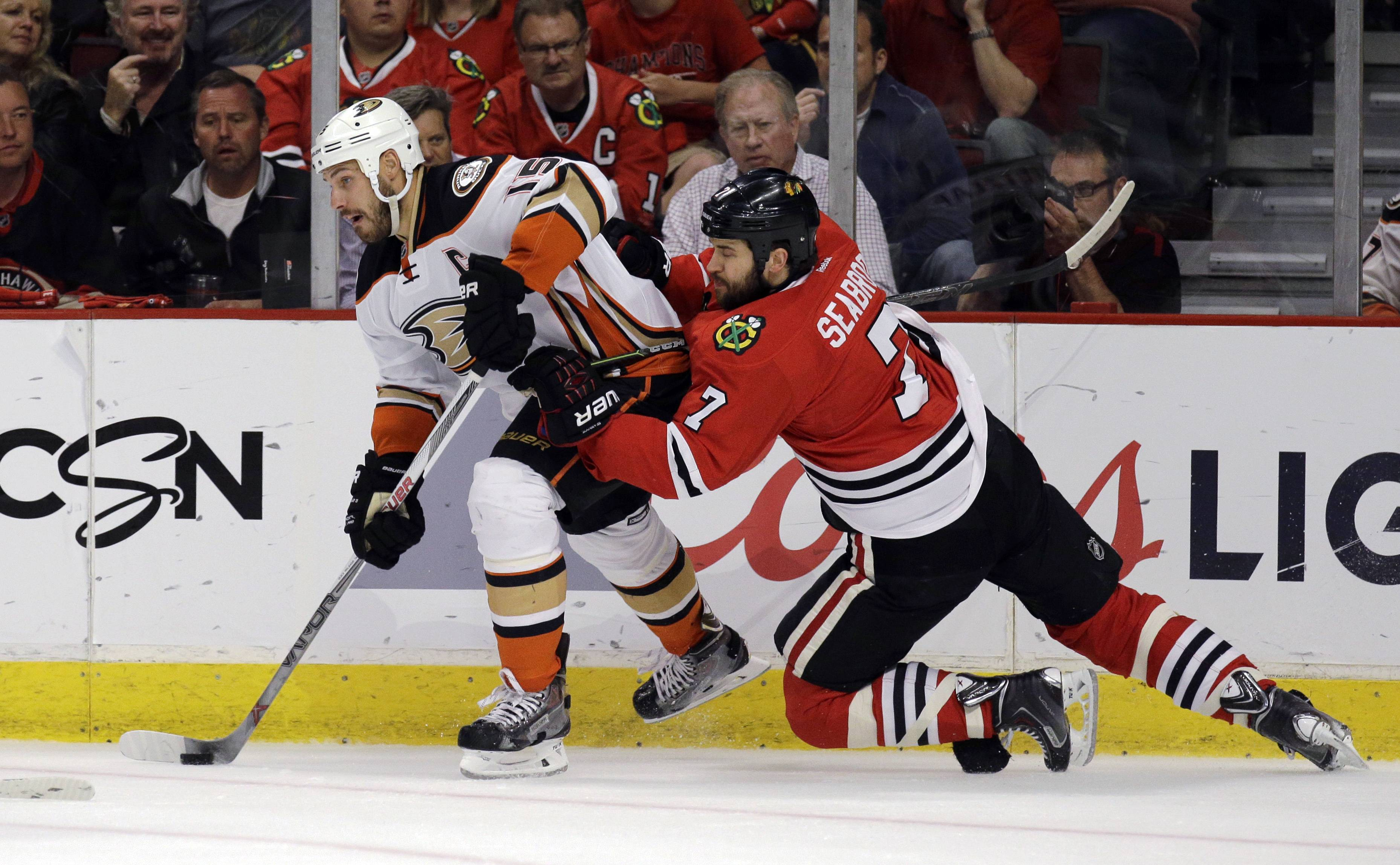 Blackhawks defenseman Brent Seabrook defends Ducks center Ryan Getzlaf during Saturday's Game 4 at the United Center.