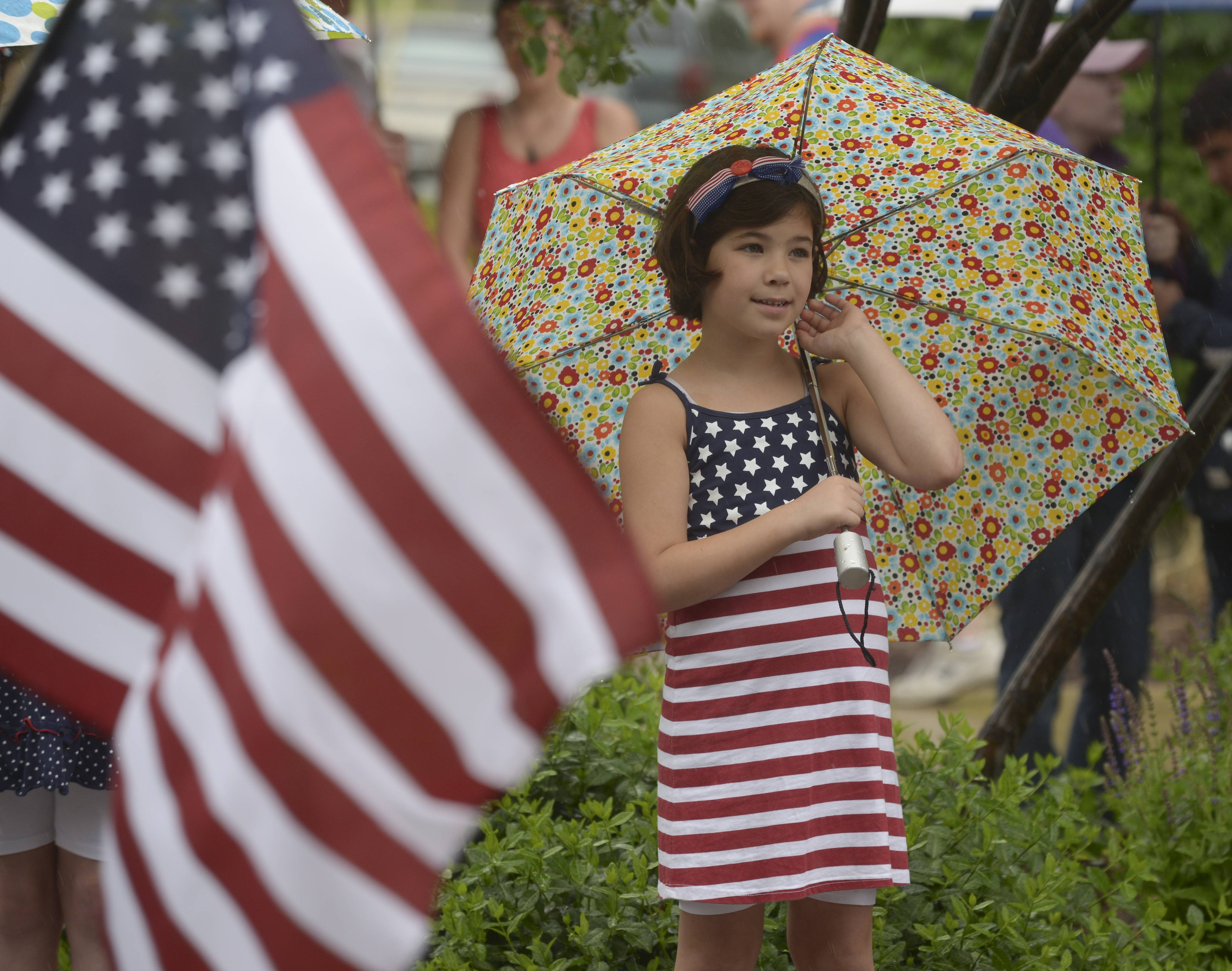 Reagan Pasqualicchio, 9 of Winfield watches the Wheaton Memorial Day Parade Monday.