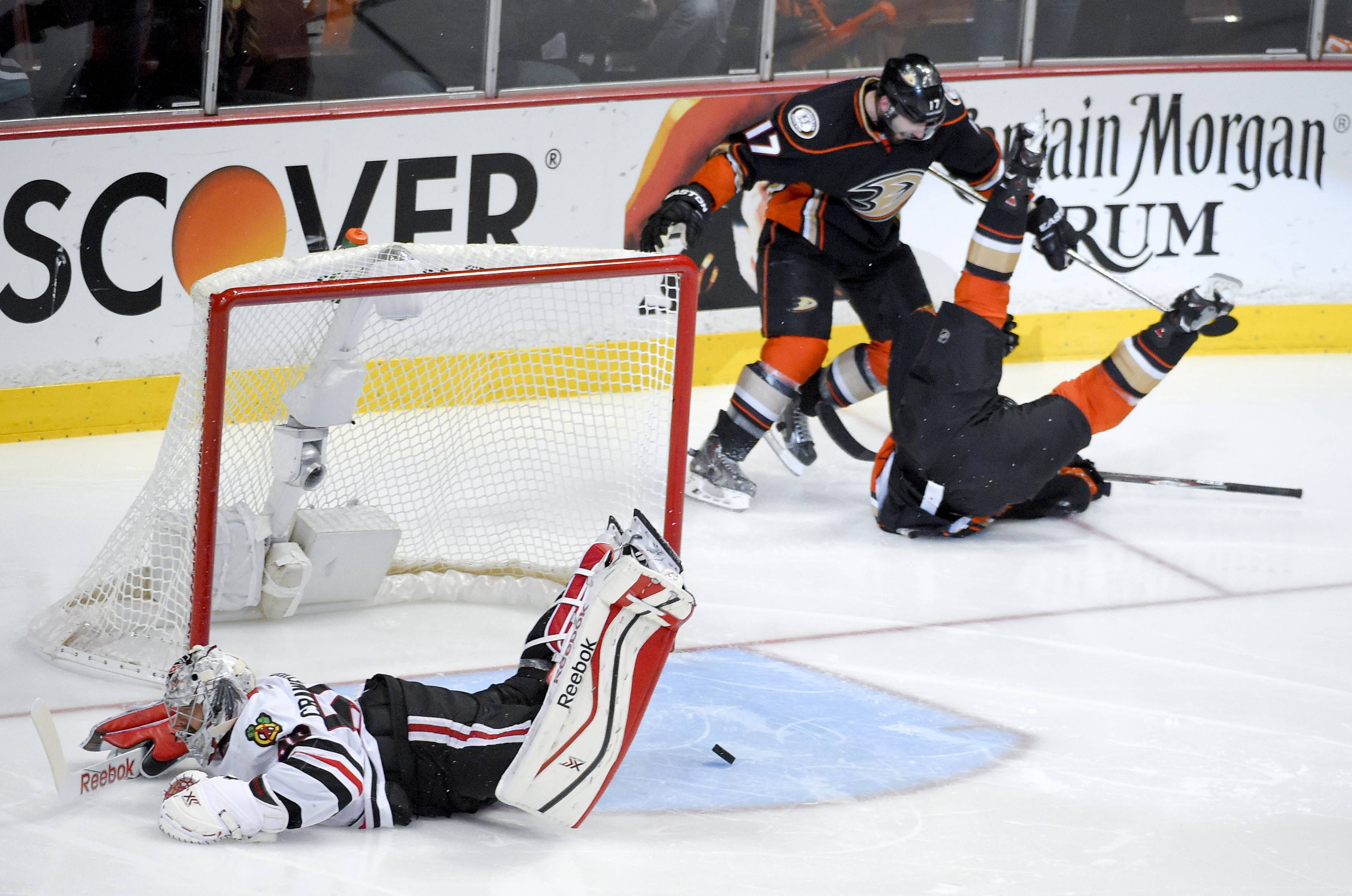 Anaheim Ducks left wing Matt Beleskey right, celebrates with Ryan Kesler after scoring the game winning goal past Chicago Blackhawks goalie Corey Crawford, left, during overtime in Game 5 of the Western Conference final of the NHL hockey Stanley Cup playoffs in Anaheim, Calif., on Monday, May 25, 2015.