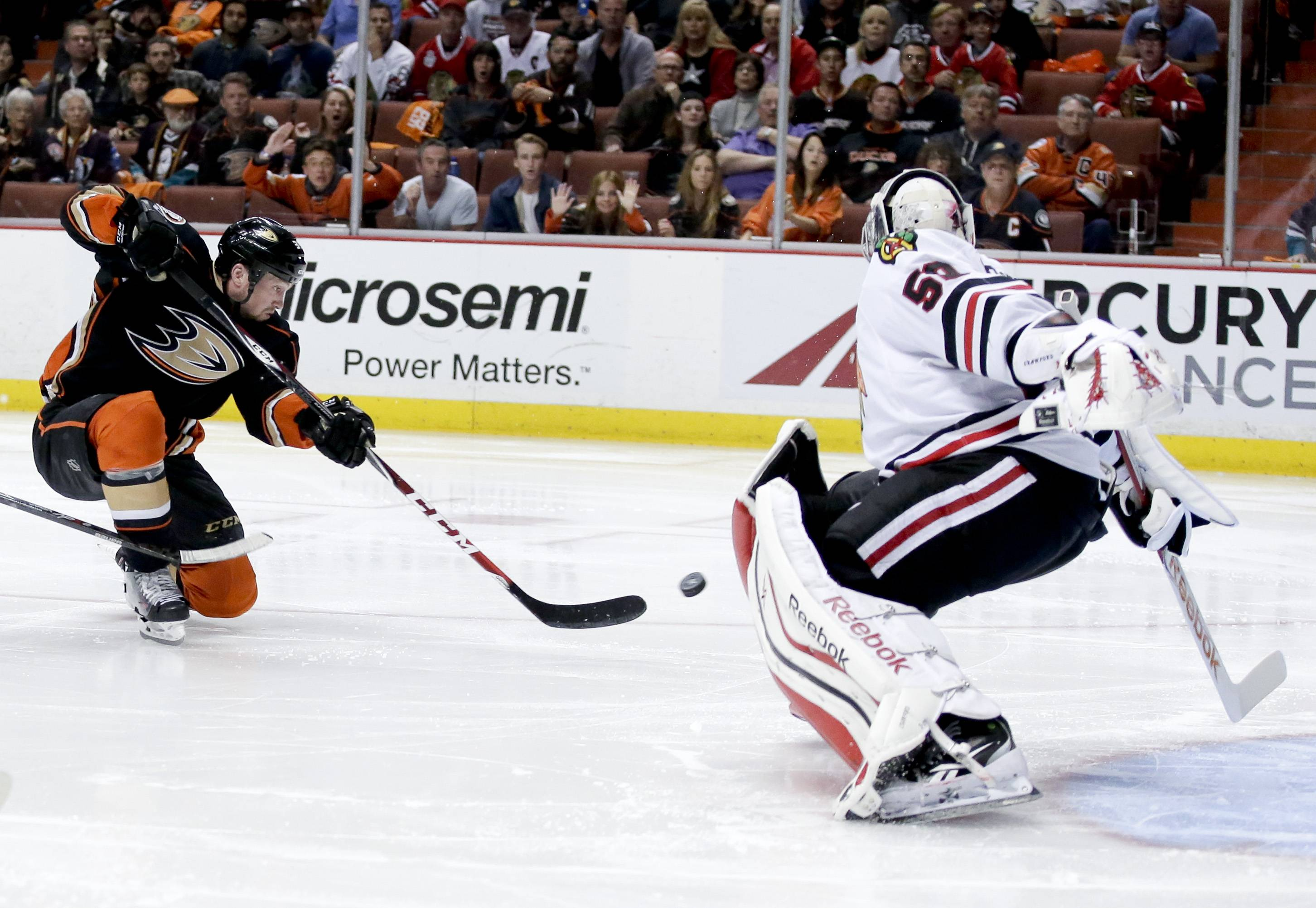 The Ducks' Matt Beleskey scores the game-winning goal seconds into overtime past Hawks goalie Corey Crawford on Monday in Game 5 of the Western Conference final at Anaheim, Calif.