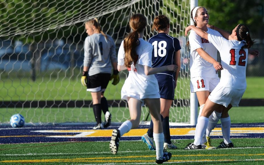Barrington's Jenna Szczesny, second from right, celebrates the second of her 2 goals with teammate Megan Fox during the Class 3A Glenbrook South sectional semifinal against Buffalo Grove on Tuesday.