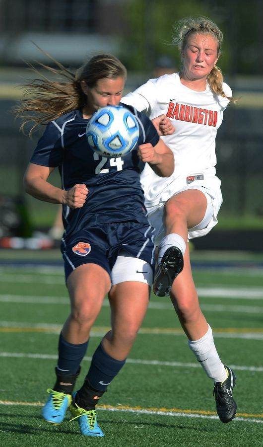 Barrington's Kayla Keck, right, directs the ball past Buffalo Grove's Sara Busse during the Class 3A Glenbrook South sectional semifinals on Tuesday.