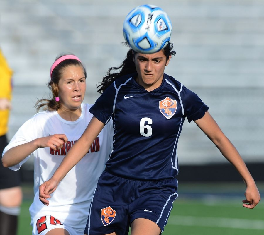 Buffalo Grove's Courtney Lee, right, gets in front of Barrington's Ann Marie Niro for a header during the Class 3A Glenbrook South sectional semifinals on Tuesday.