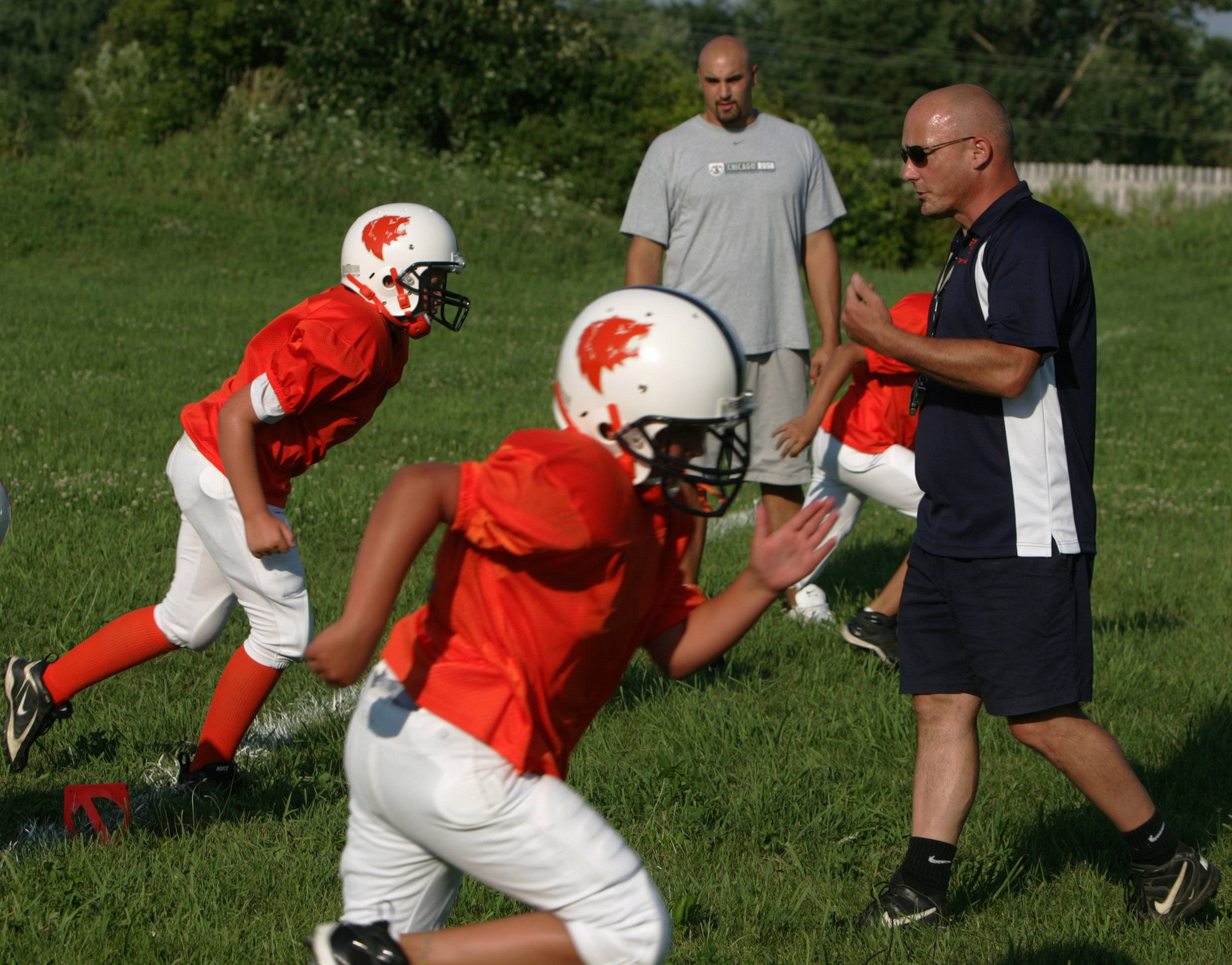 Gilberts Grizzlies former head coach Mike Curran is pictured running team drills in 2008.
