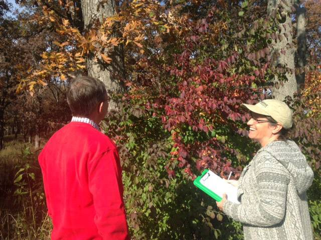Mary Fortmann, sustainable landscapes coordinator for Conserve Lake County, right, consults with a property owner as part of the Conservation@Home program. Grayslake has become the first community in Lake County to offer rebates to property owners who participate in the program.