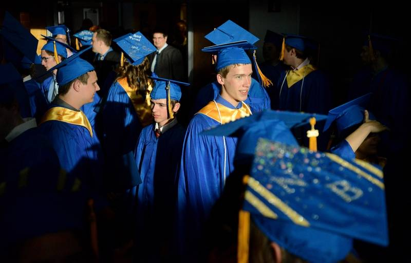 alex vonderhaar center facing right joins other grads to return their gowns after graduating