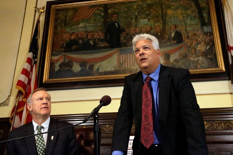 Illinois Gov. Bruce Rauner, left, looks on as state Rep. Jack Franks, a Marengo Democrat, talks to reporters in January.