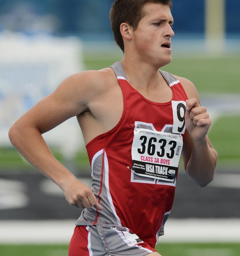 Mundelein's Bryce Richards competes in the 1,600-meter run during the Class 3A state meet preliminaries in Charleston on Friday.