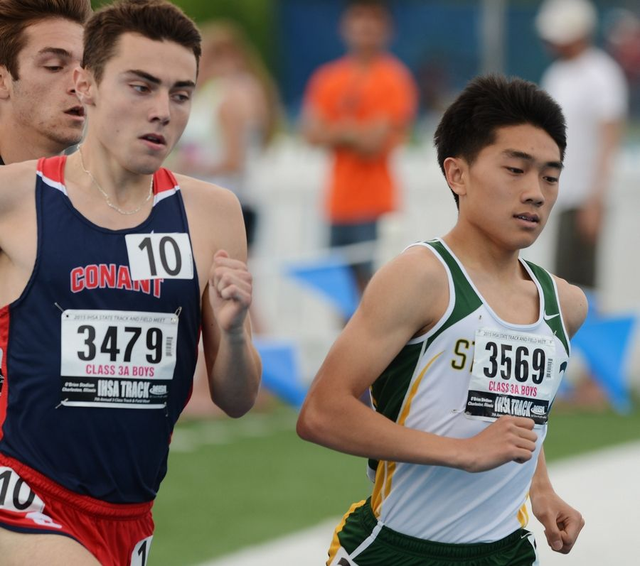 Stevenson's Sam Oh, right, and Conant's Zach Dale compete in the 1,600-meter run during the Class 3A state meet preliminaries in Charleston on Friday.