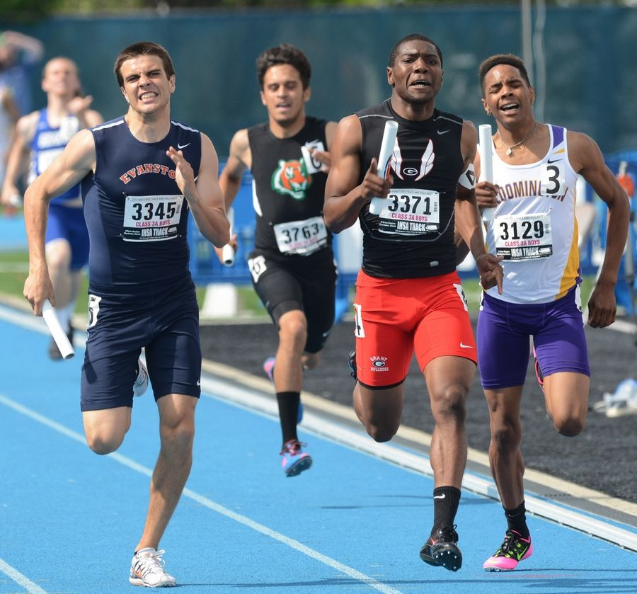 Grant's Octavian Wells, middle, heads for the finish line in the 1,600-meter relay during the Class 3A state meet preliminaries in Charleston on Friday.