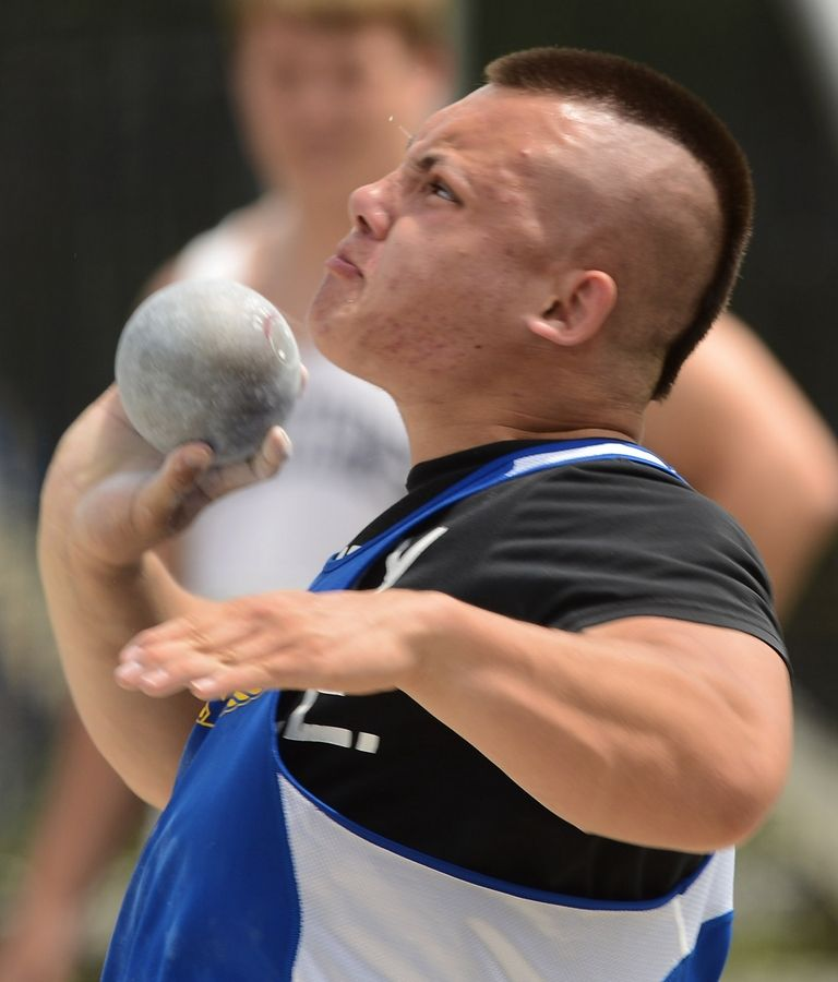 Warren's Matt Sladek throws the shot put during the Class 3A state meet preliminaries in Charleston on Friday.