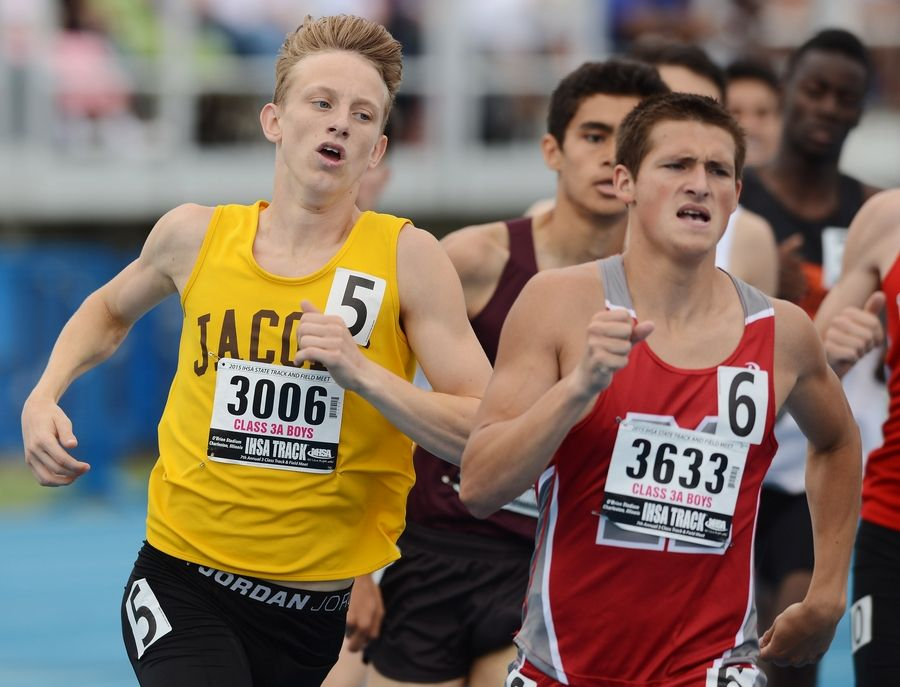 Jacobs' Matt Goldby, left, and Mundelein's Bryce Richards compete in the 800-meter run during the Class 3A state meet preliminaries in Charleston on Friday.