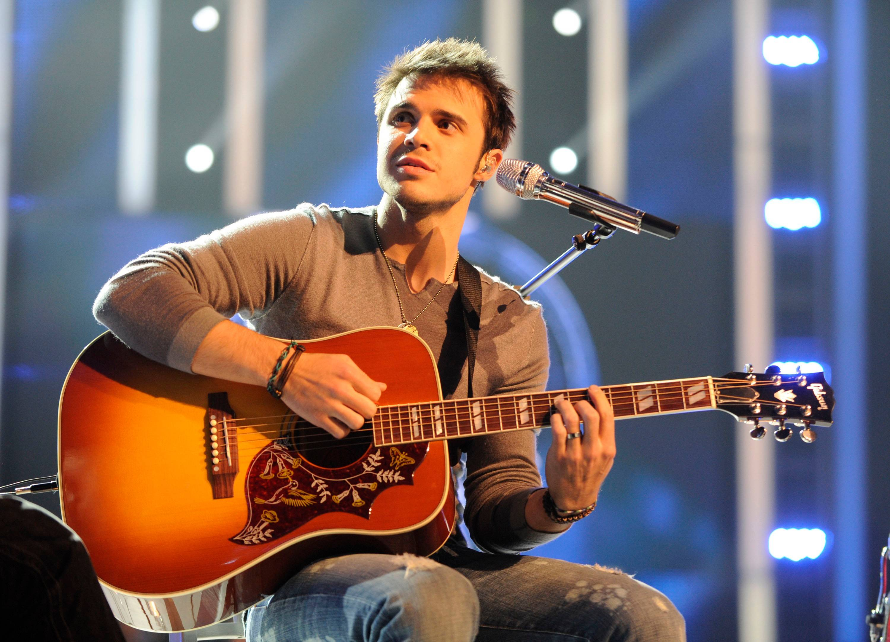"Kris Allen, the 2009 winner of ""American Idol,"" performs in concert at North Central College's Pfeiffer Hall in Naperville on Saturday, May 30."