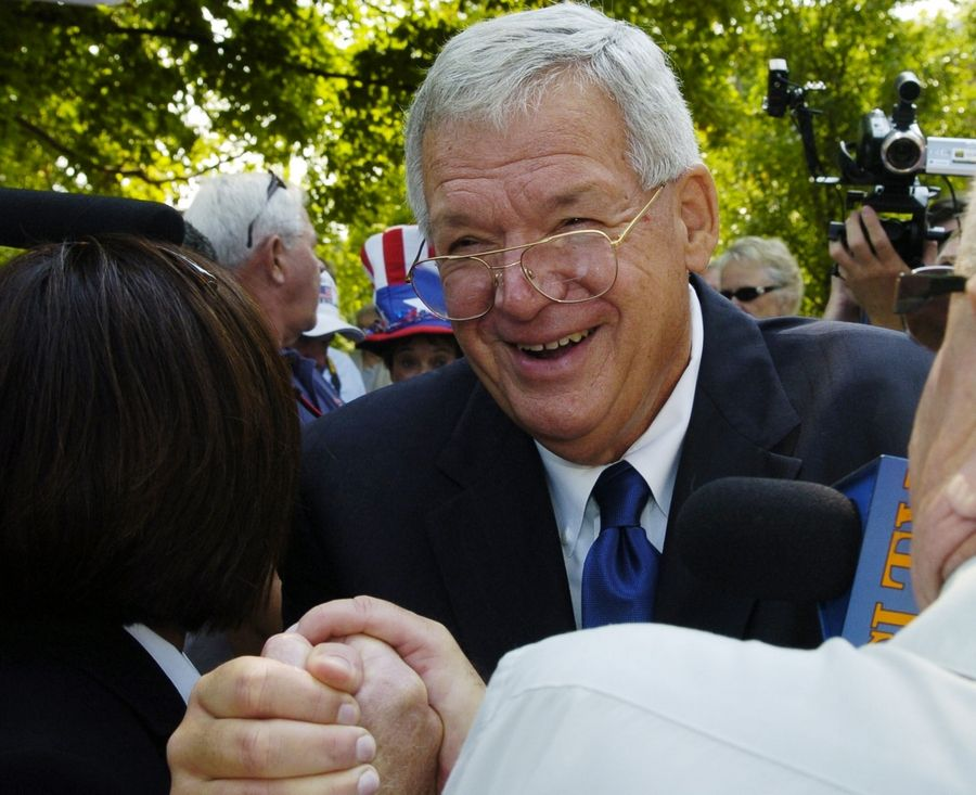 Congressman Dennis Hastert in 2008 shakes hands with supporters following his announcement that he won't run for re-election outside the old Kendall County Courthouse in Yorkville. People from Yorkville who knew Hastert say they've never had reason to suspect the former congressman of any wrongdoing.